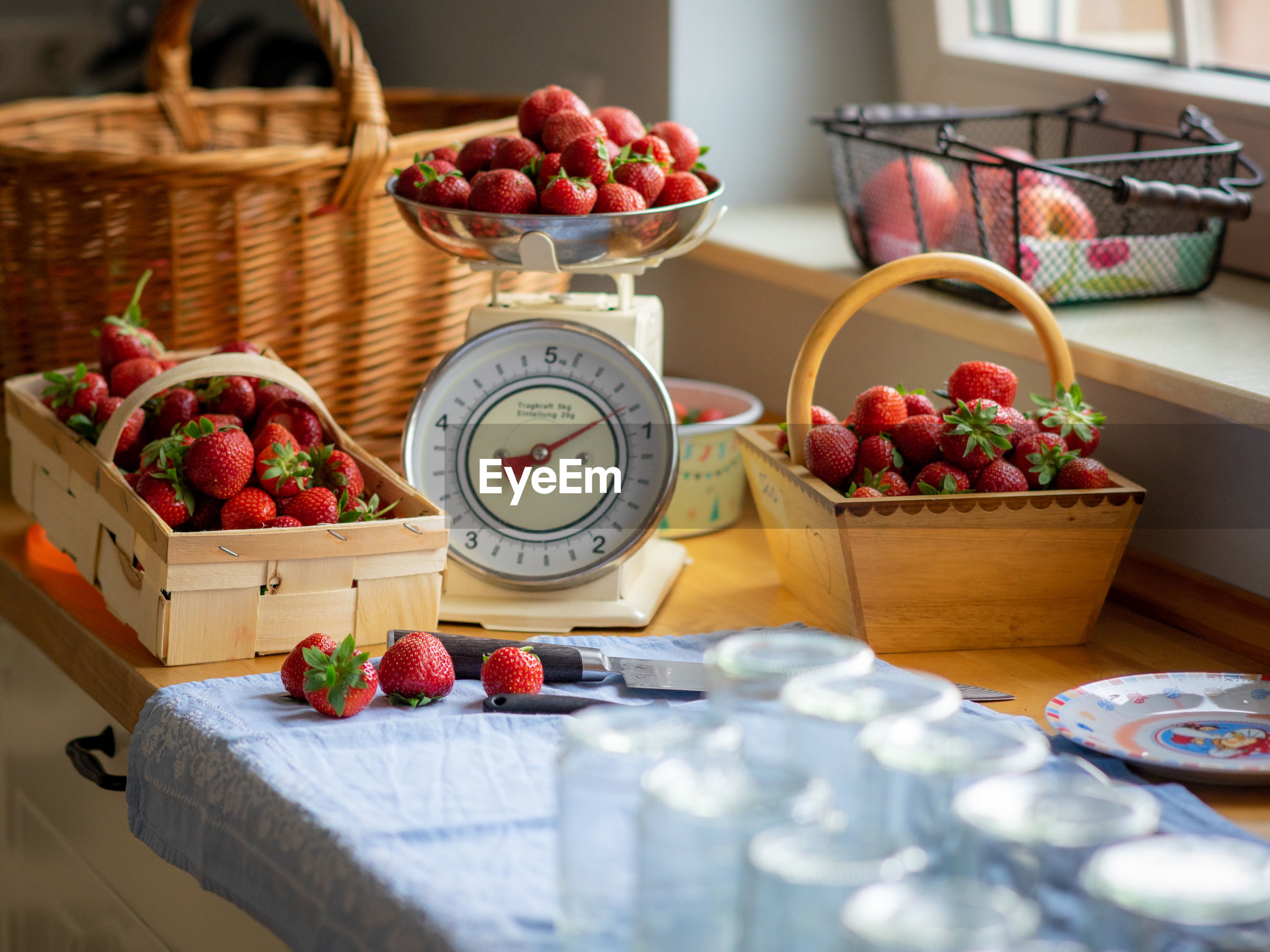 Close-up of strawberries for sale in basket on table