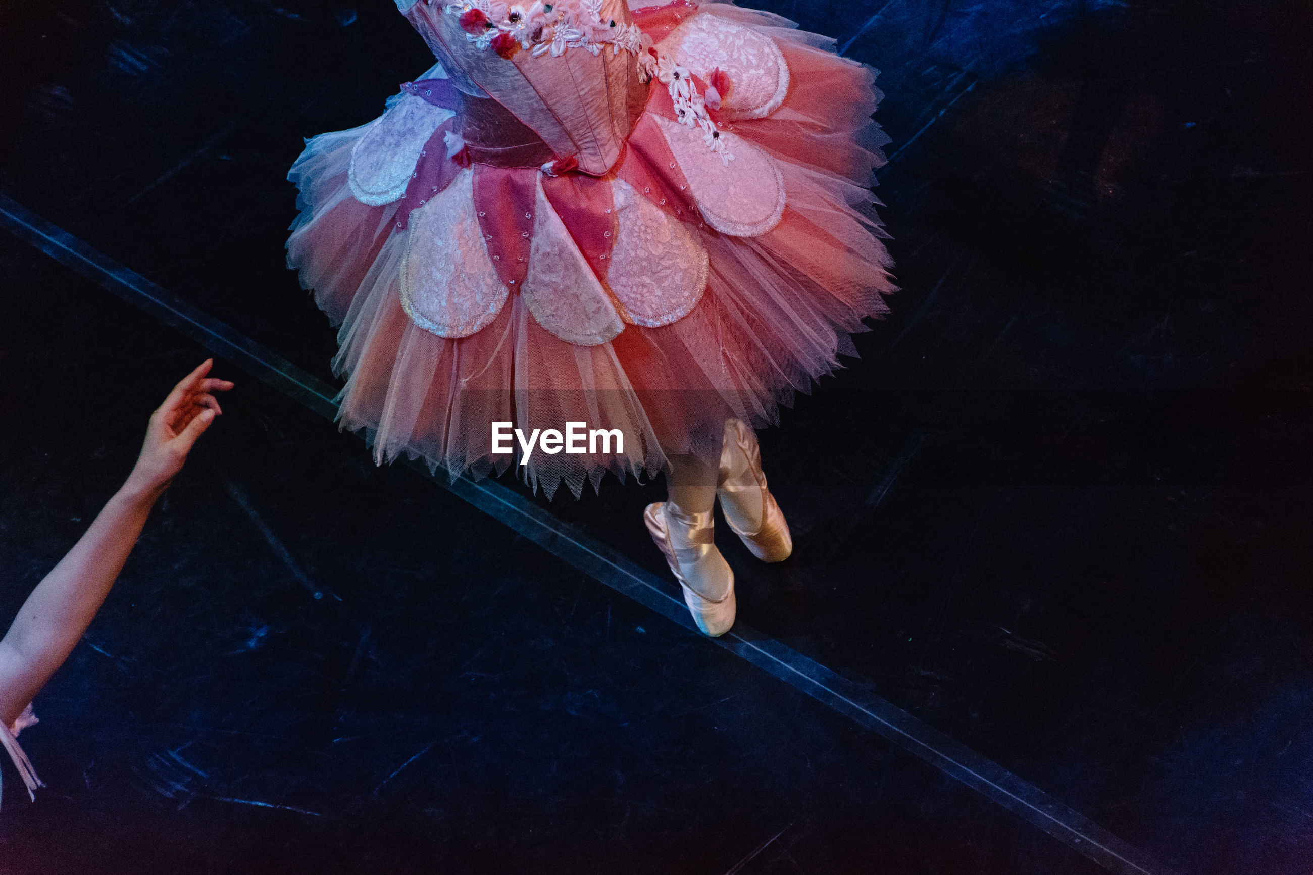 Low section of ballerina performing on stage