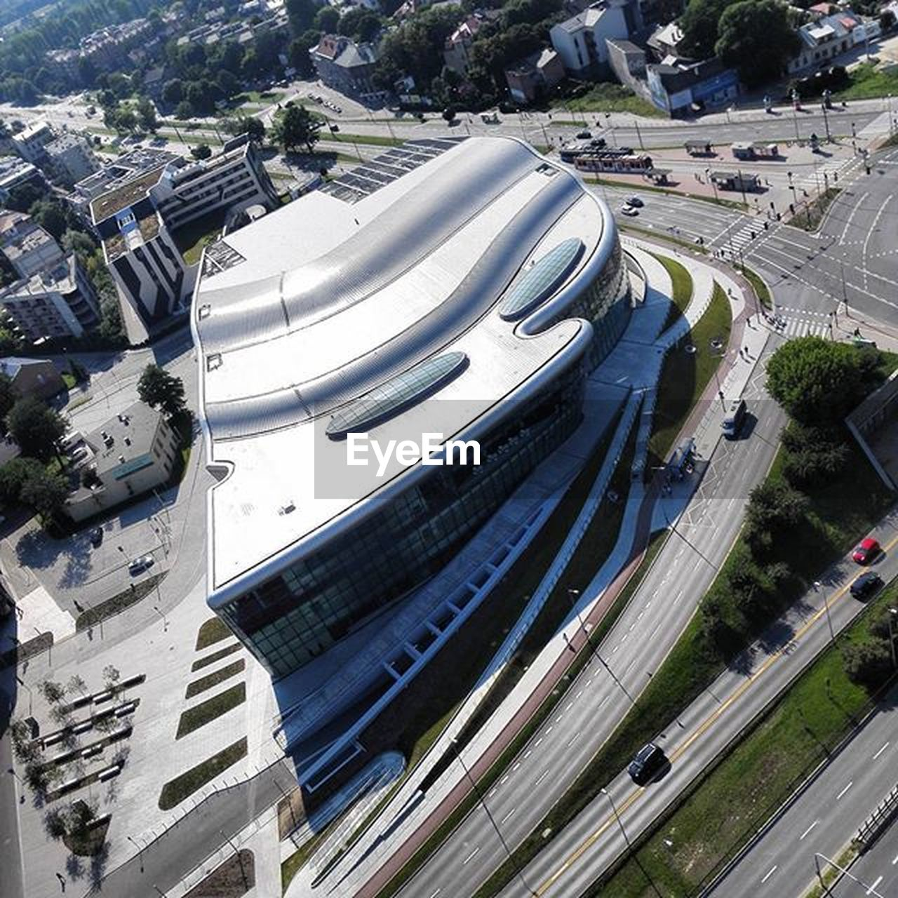 architecture, high angle view, built structure, transportation, road, highway, city, traffic, street, car, bridge - man made structure, city street, building exterior, aerial view, outdoors, curve, day, modern, no people, cityscape, tree