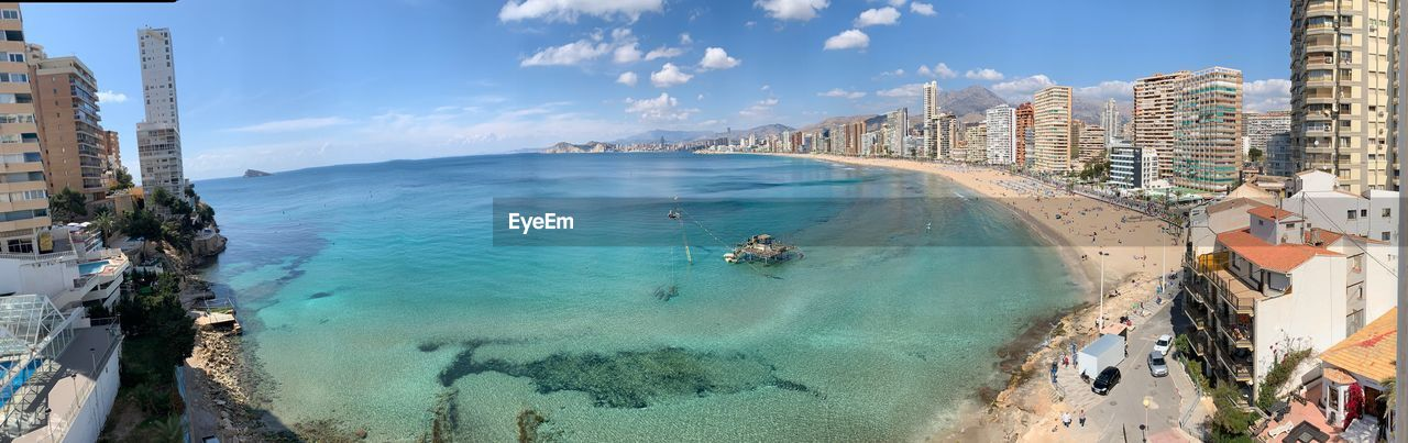 water, sea, sky, building exterior, beach, architecture, built structure, land, city, nature, day, scenics - nature, incidental people, panoramic, beauty in nature, cloud - sky, coastline, travel, travel destinations, outdoors, turquoise colored