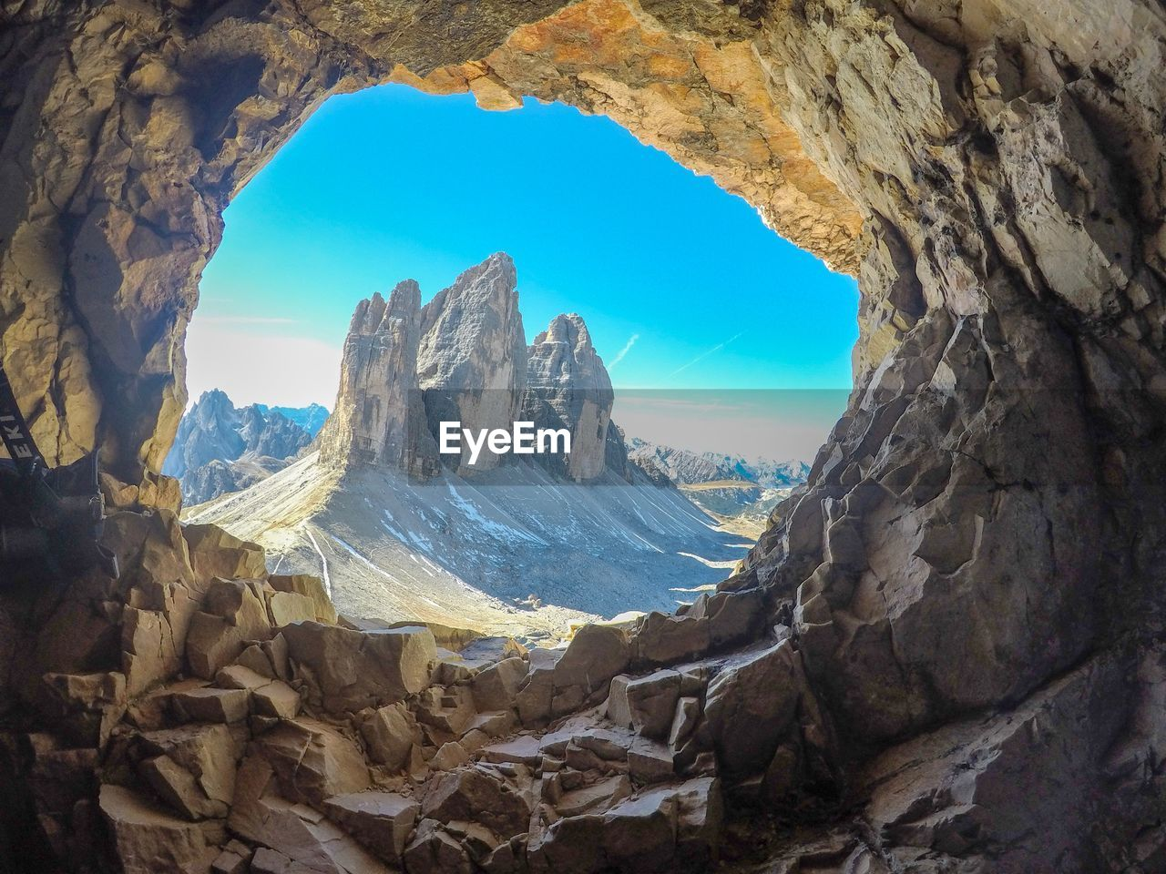 rock, rock - object, solid, rock formation, beauty in nature, scenics - nature, sky, mountain, nature, tranquility, tranquil scene, no people, non-urban scene, day, physical geography, arch, mountain range, rough, geology, idyllic, natural arch, outdoors, formation, eroded