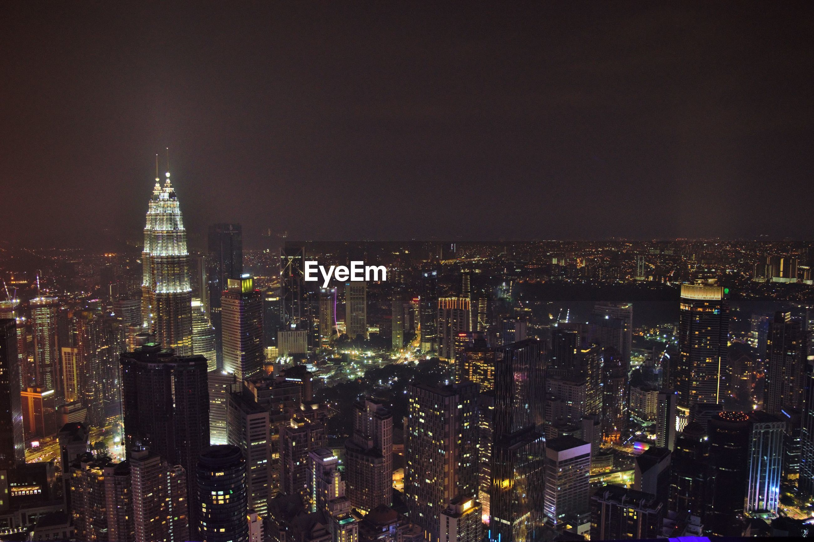 AERIAL VIEW OF CITY BUILDINGS AT NIGHT