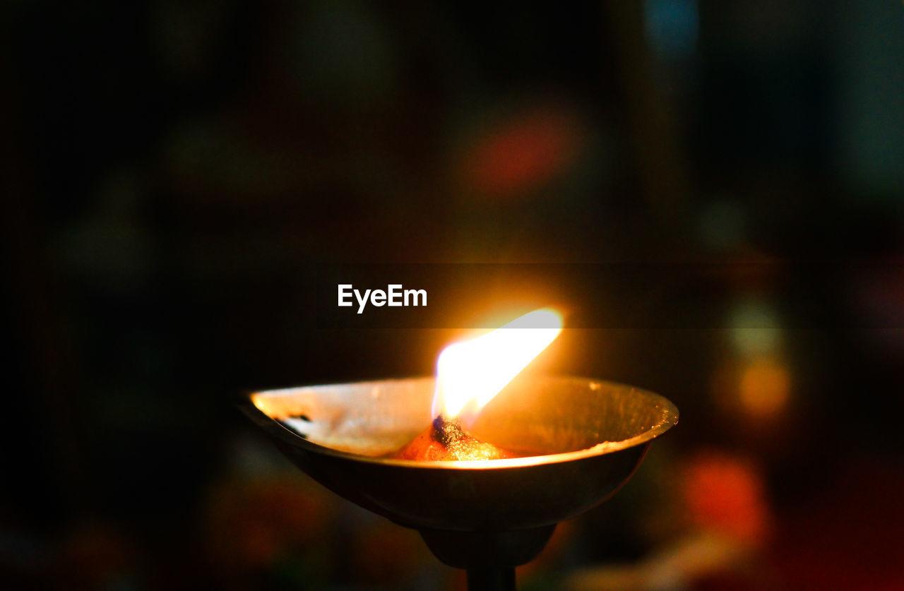 Close-up of lit diya