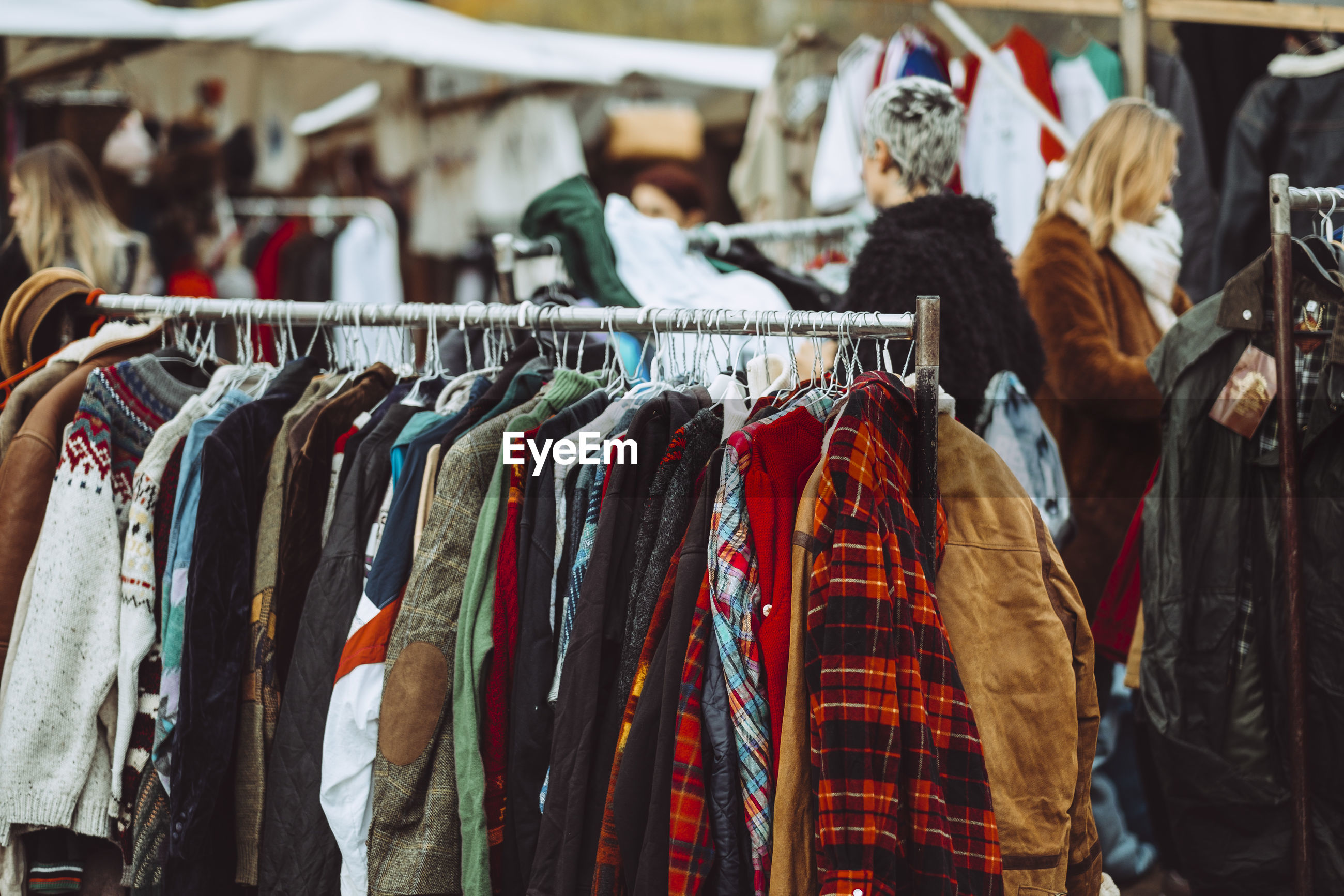 Clothes hanging on rack at market