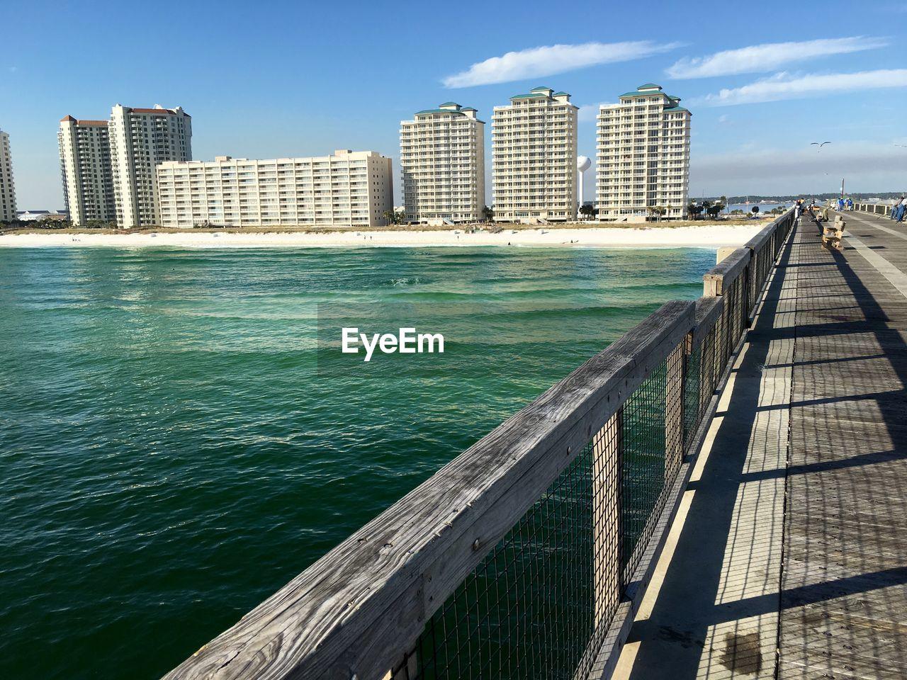 Footbridge over sea in city