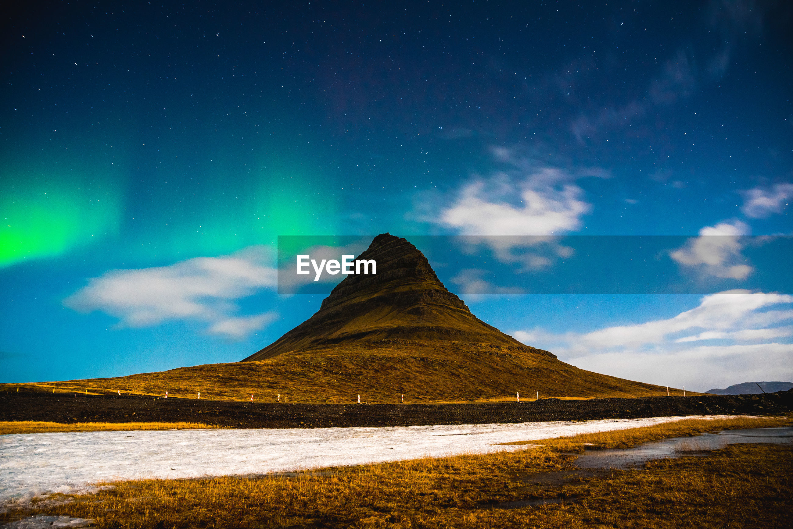 Scenic view of kirkjufell mountain against night sky with aurora borealis