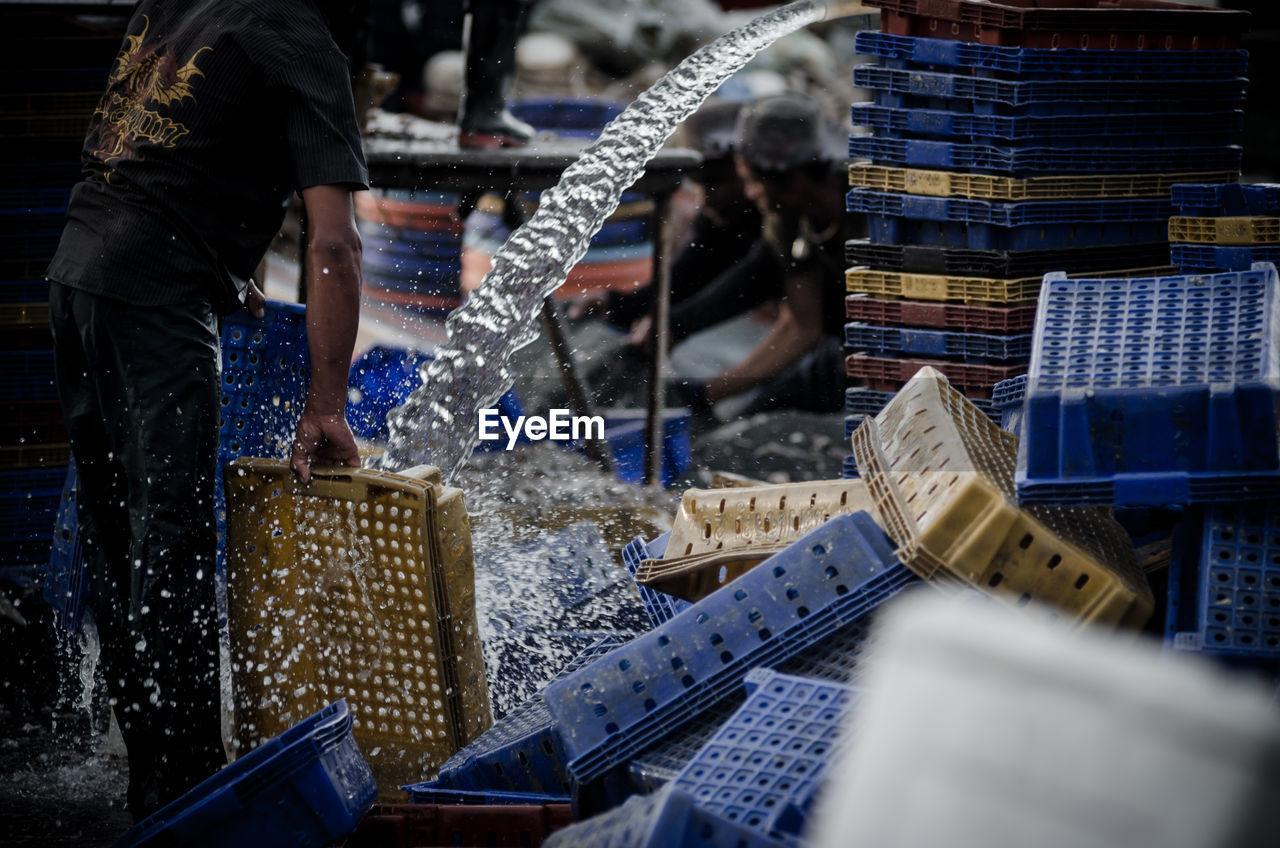 Fisherman Washing Baskets