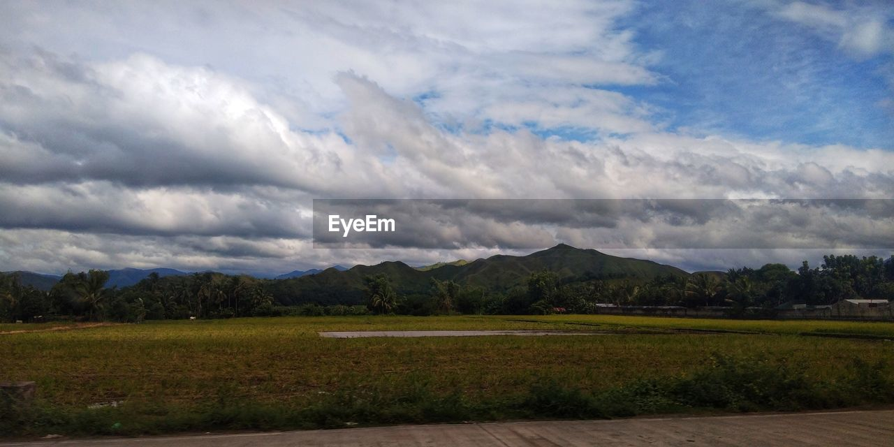 cloud - sky, sky, tranquil scene, tranquility, landscape, environment, scenics - nature, beauty in nature, no people, nature, non-urban scene, grass, mountain, plant, land, field, day, outdoors, mountain range, idyllic