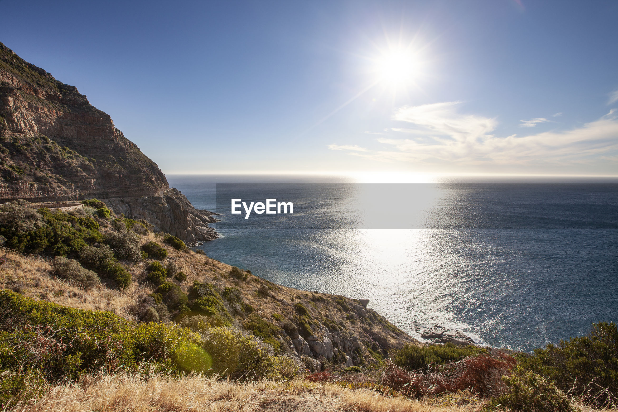 SCENIC VIEW OF SEA AGAINST BRIGHT SKY