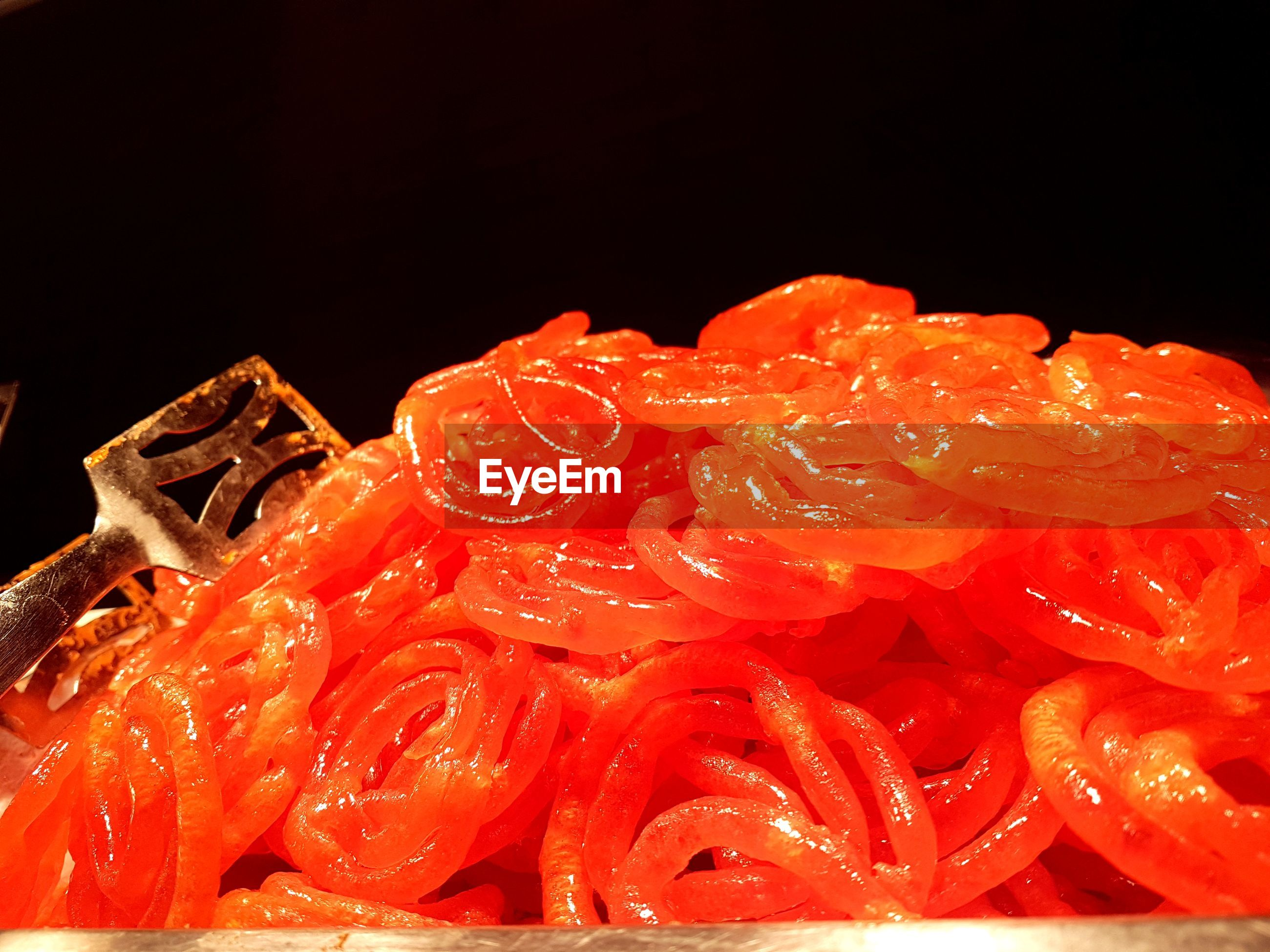 Close-up of jalebis against black background