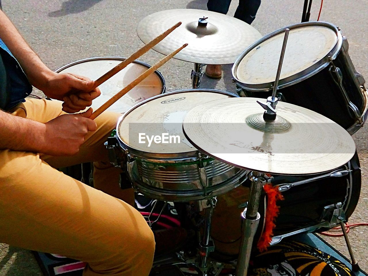 music, drum - percussion instrument, musical instrument, drumstick, drummer, drum kit, arts culture and entertainment, musician, musical equipment, human hand, cymbal, real people, human body part, one person, men, playing, holding, indoors, recording studio, skill, sitting, people, day, close-up, adult