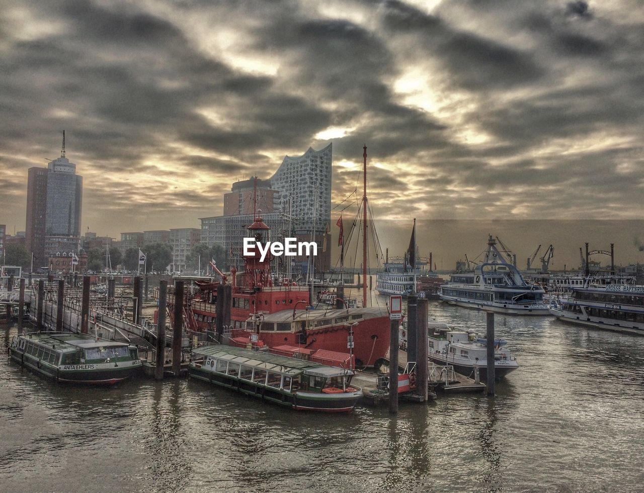 architecture, sky, city, built structure, transportation, water, building exterior, skyscraper, nautical vessel, no people, cloud - sky, travel destinations, river, harbor, modern, outdoors, cityscape, day