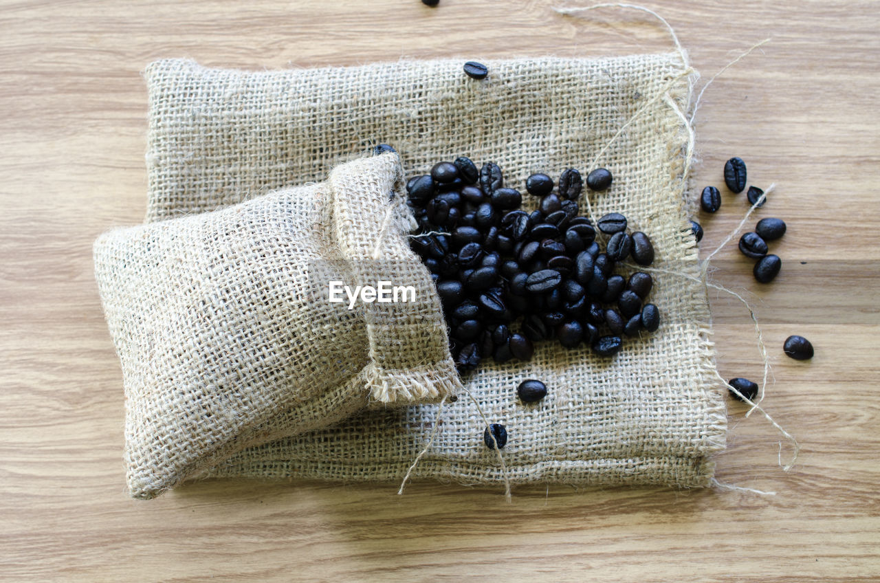 table, indoors, blueberry, still life, wood - material, high angle view, food and drink, freshness, no people, healthy eating, studio shot, food, close-up, day, black olive