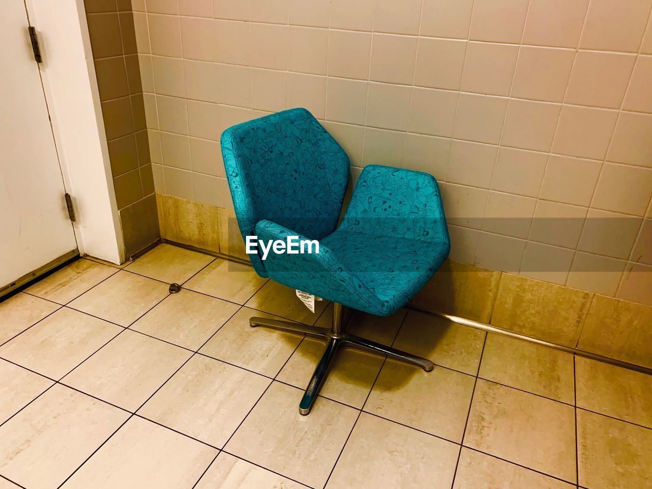 flooring, tile, indoors, tiled floor, blue, wall - building feature, domestic room, no people, seat, chair, home interior, absence, furniture, home, bathroom, still life, hygiene, empty, armchair, wall, clean, turquoise colored