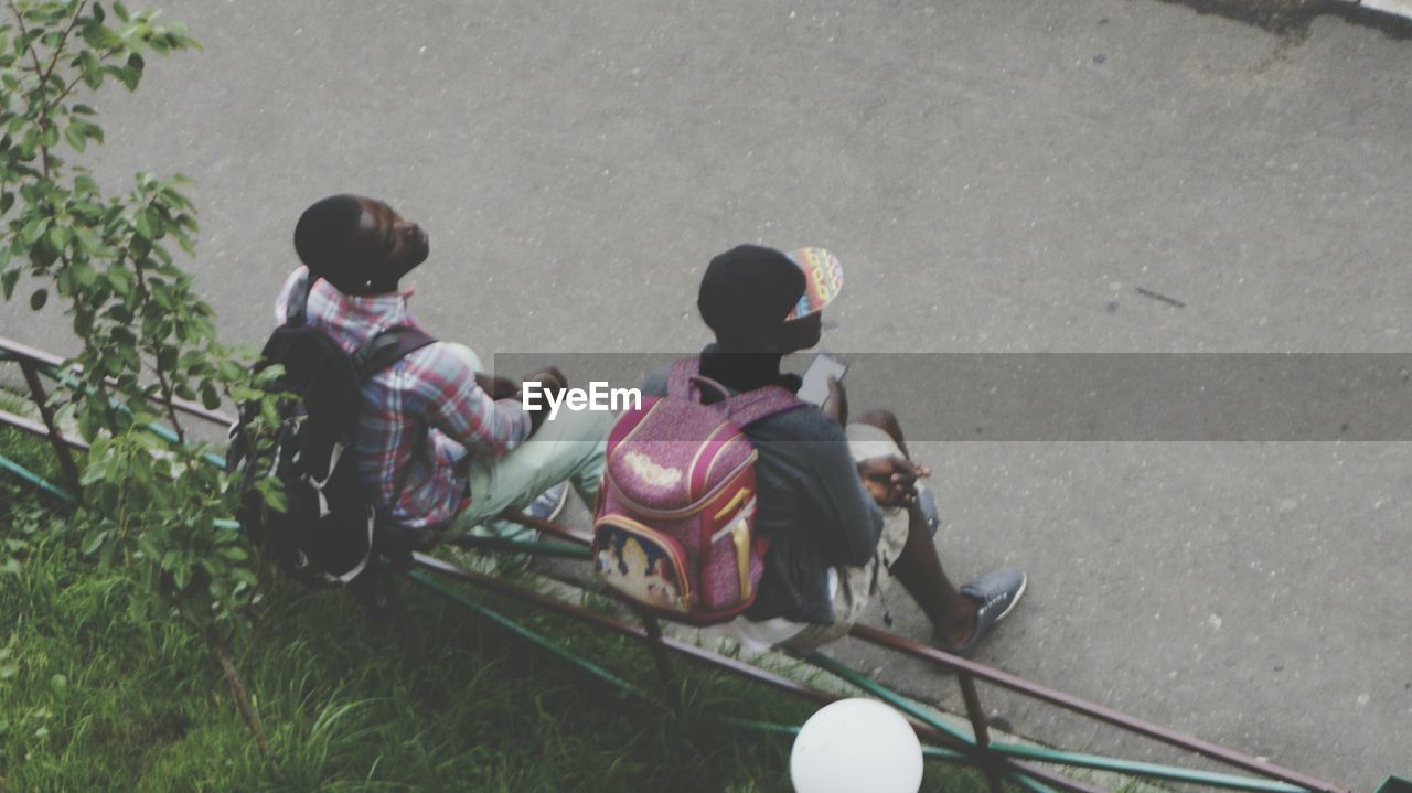 childhood, real people, high angle view, family, boys, girls, sitting, outdoors, togetherness, day, leisure activity, lifestyles, grass, full length, child, men, bonding, nature, people