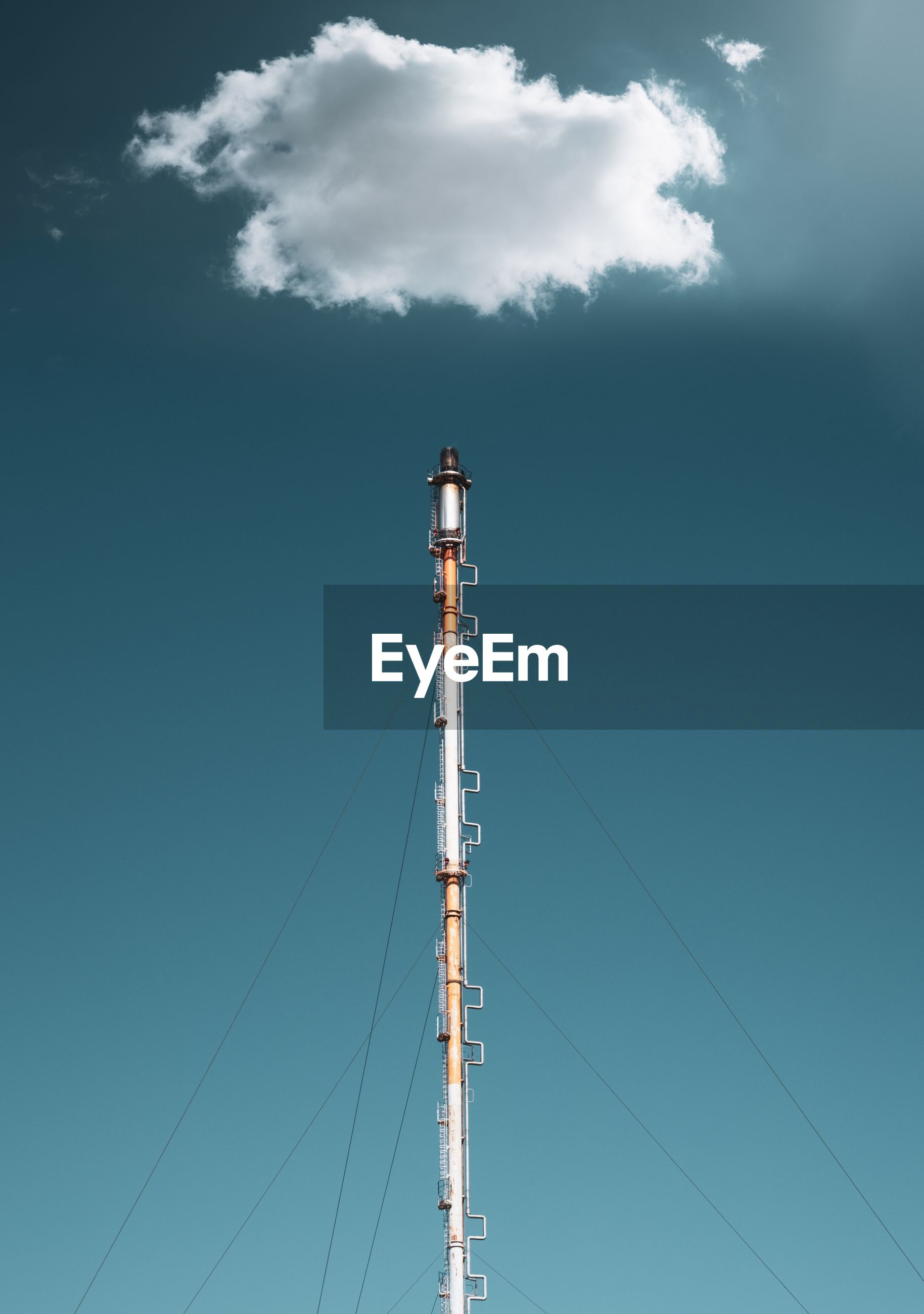 Low angle view of industrial tower against sky