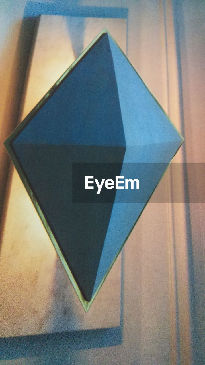 triangle shape, no people, paper, indoors, close-up, multi colored, day