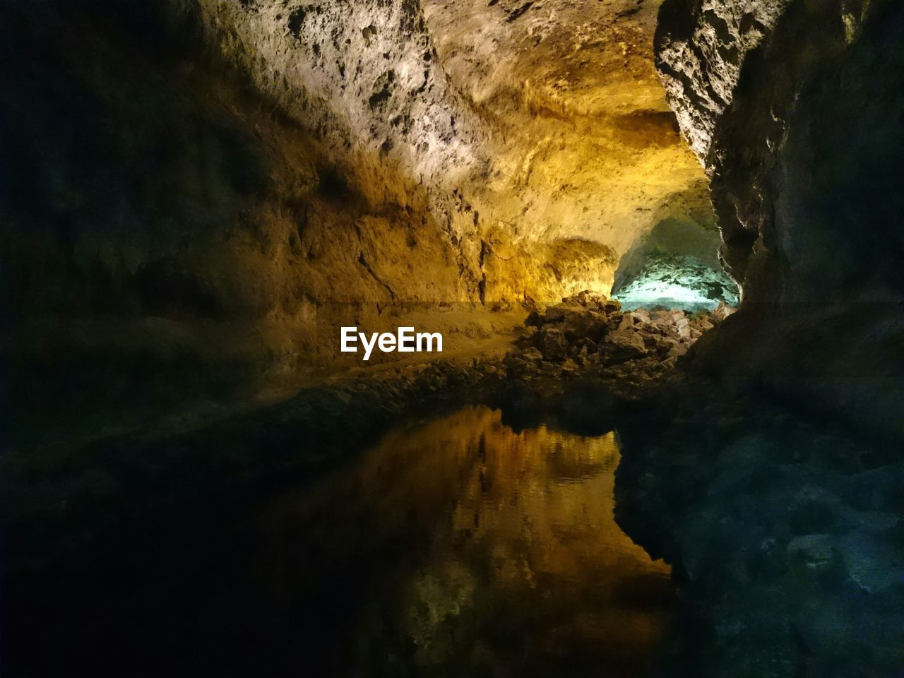 Water in illuminated cave