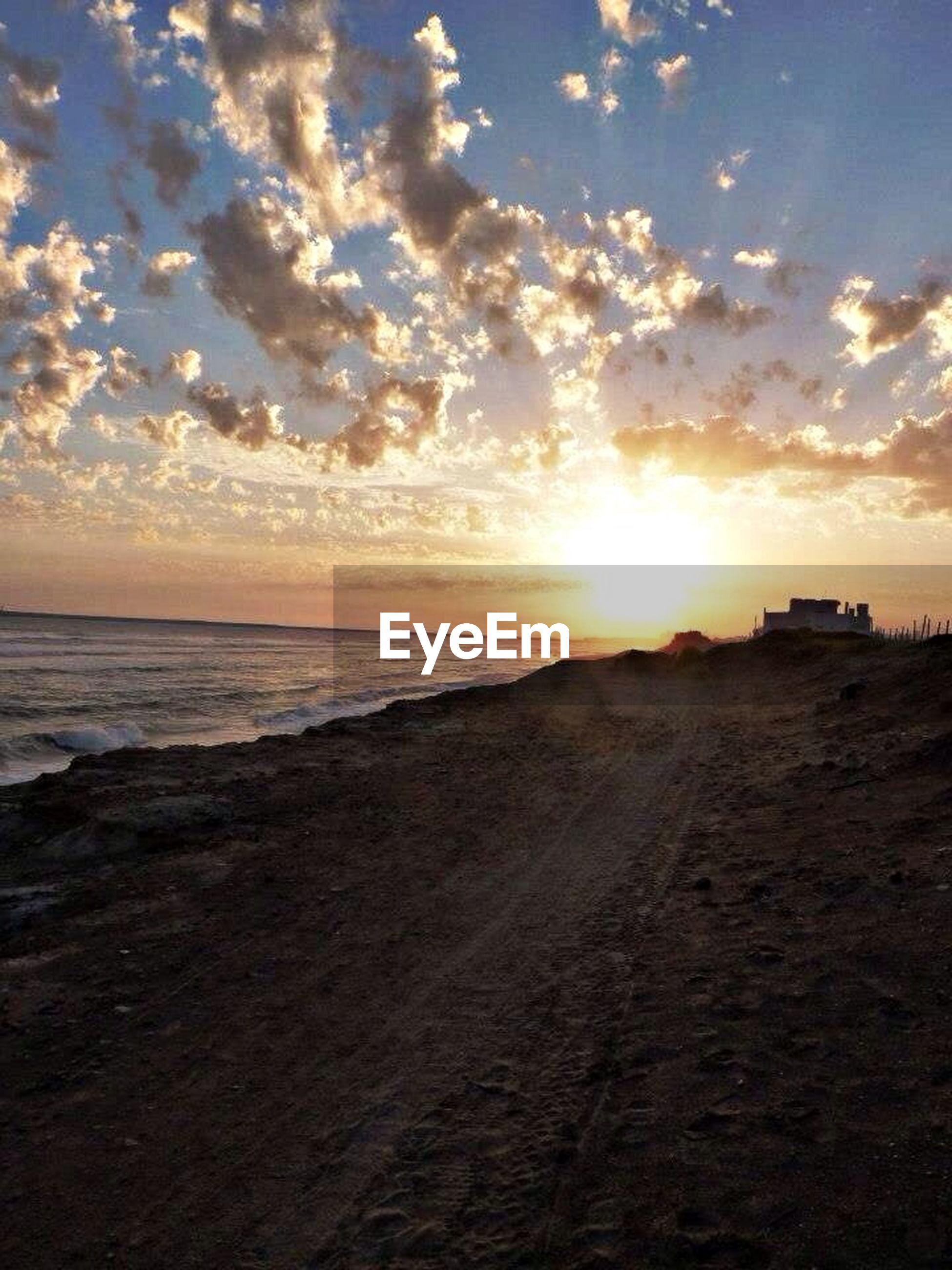 sea, beach, sunset, horizon over water, water, sun, sky, shore, scenics, tranquil scene, beauty in nature, sand, tranquility, sunlight, cloud - sky, sunbeam, nature, idyllic, wave, coastline