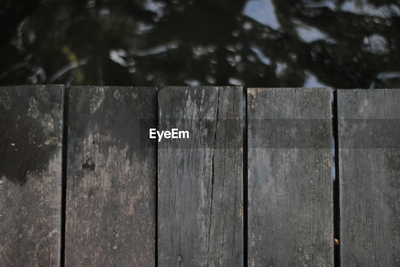 wood - material, pattern, close-up, textured, no people, barrier, focus on foreground, fence, boundary, safety, day, backgrounds, wood, side by side, outdoors, metal, plank, nature, full frame, security