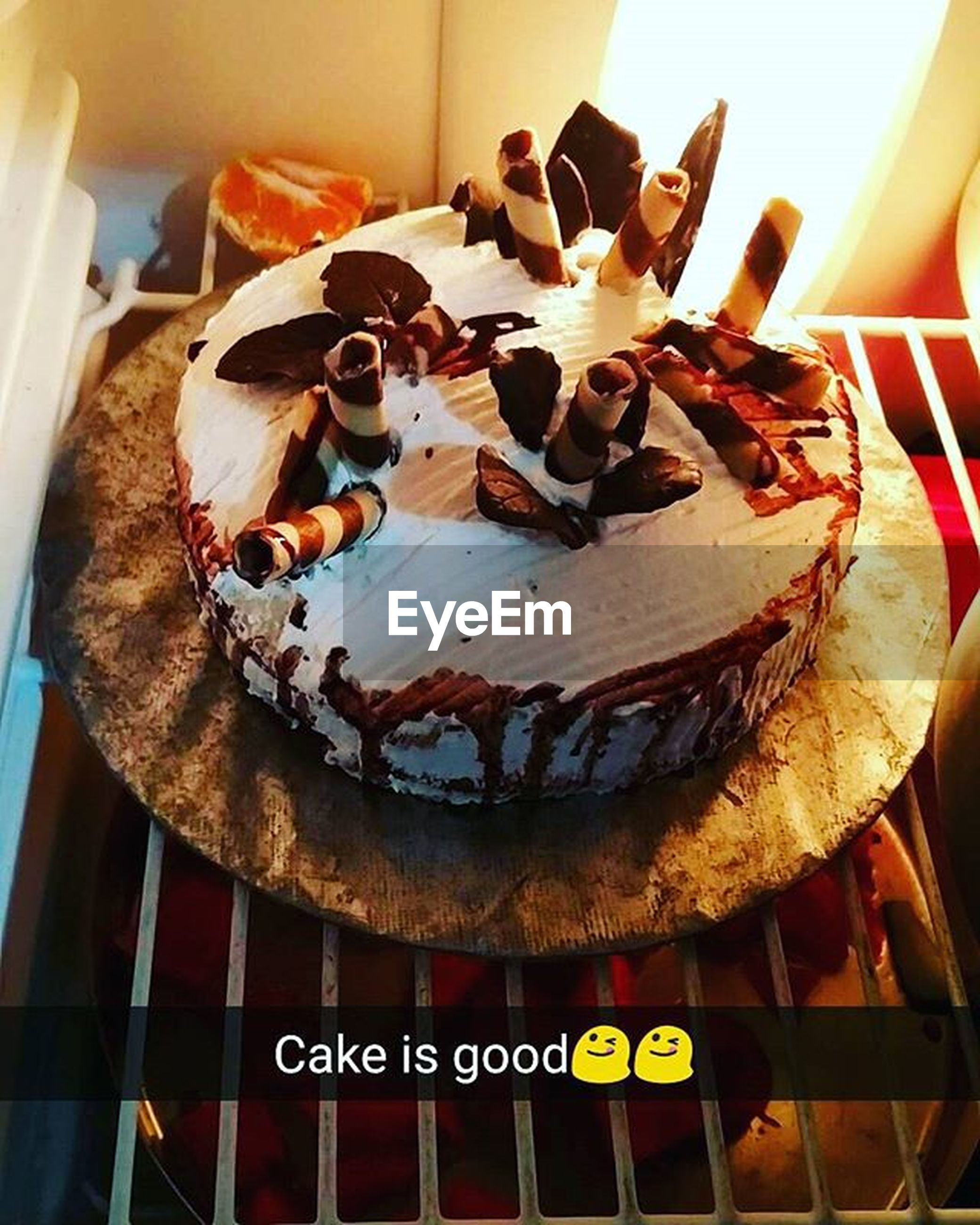 indoors, food and drink, text, food, sweet food, table, western script, indulgence, dessert, cake, freshness, plate, still life, unhealthy eating, close-up, ready-to-eat, high angle view, no people, communication, decoration