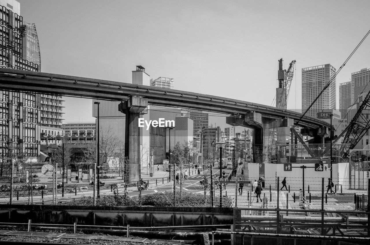 TRAIN ON BRIDGE IN CITY