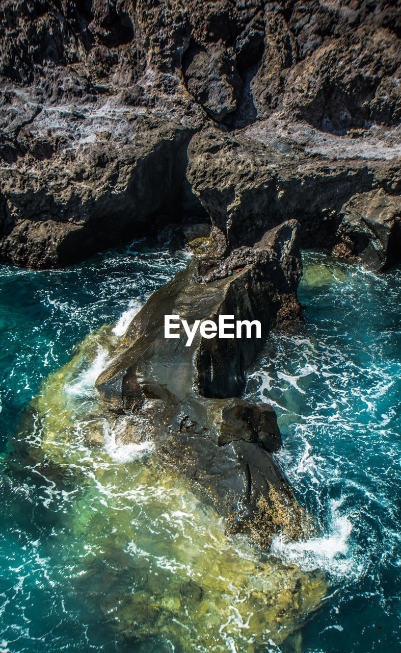 water, rock, rock - object, solid, sea, beauty in nature, motion, nature, rock formation, no people, day, scenics - nature, high angle view, outdoors, sport, land, geology, non-urban scene, aquatic sport, flowing water, flowing, power in nature