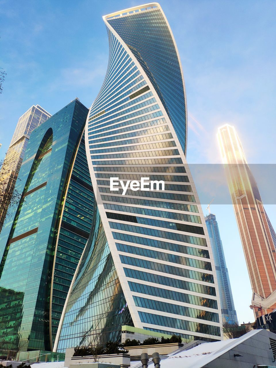 built structure, architecture, building exterior, sky, office building exterior, city, building, modern, low angle view, office, skyscraper, day, nature, tall - high, travel destinations, tower, no people, cloud - sky, reflection, outdoors, financial district