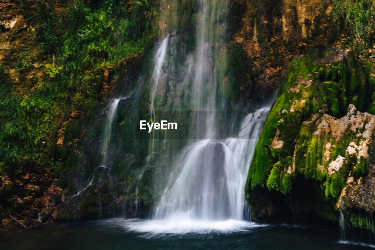 waterfall, scenics - nature, water, beauty in nature, flowing water, rock, motion, long exposure, forest, rock - object, land, environment, nature, solid, blurred motion, no people, power in nature, tree, plant, outdoors, rainforest, flowing, falling water