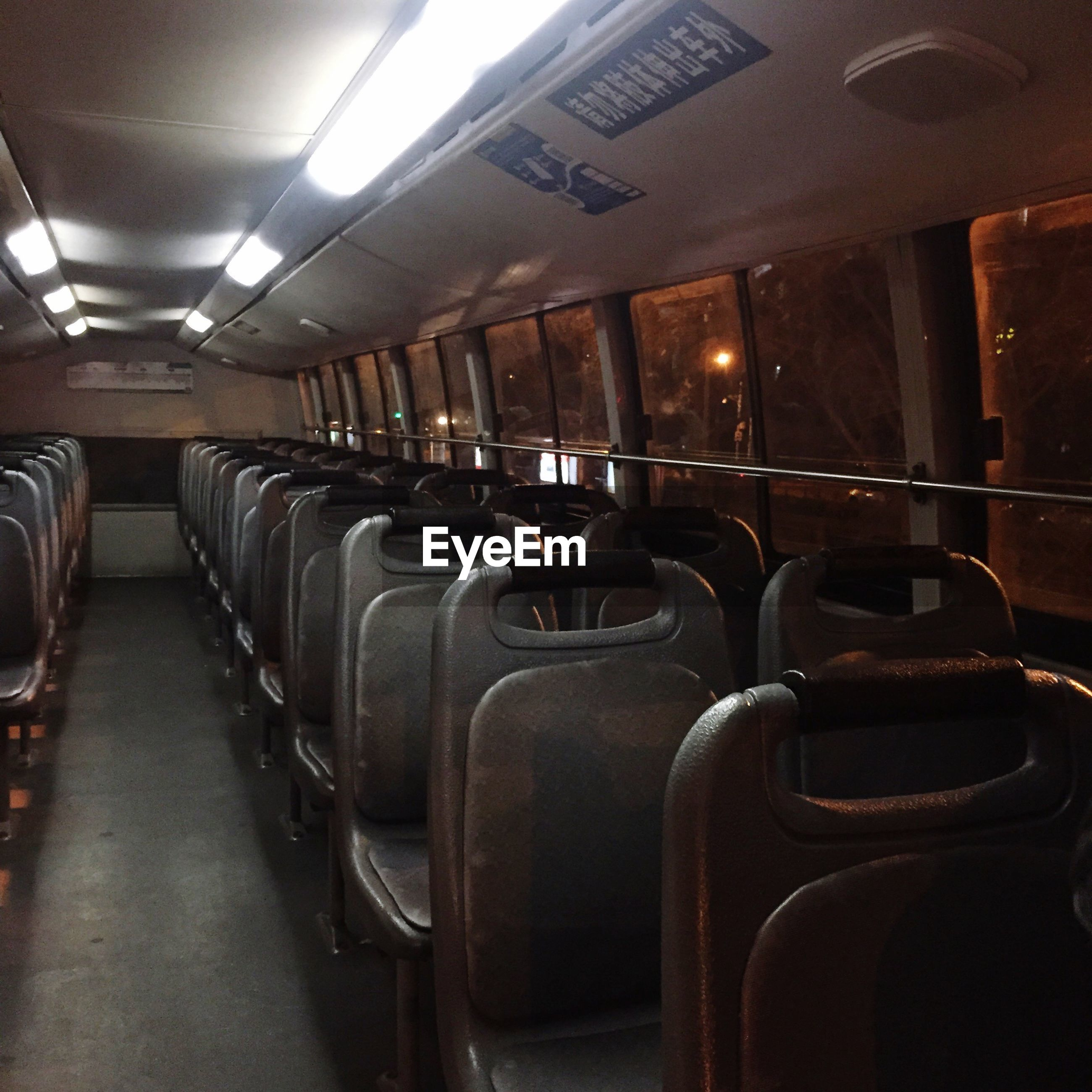 indoors, in a row, vehicle seat, illuminated, luxury, no people, chair
