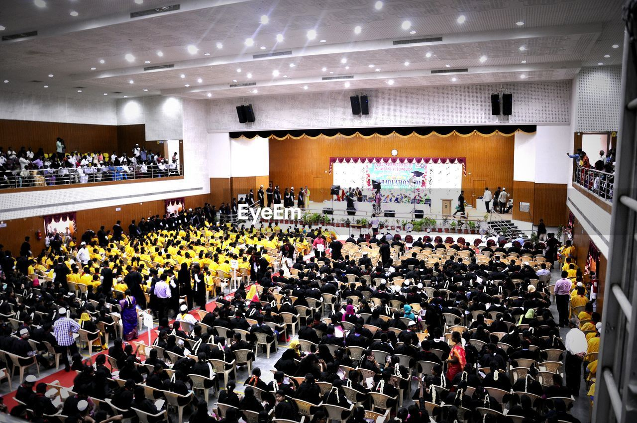 large group of people, indoors, auditorium, real people, education, crowd, day, people