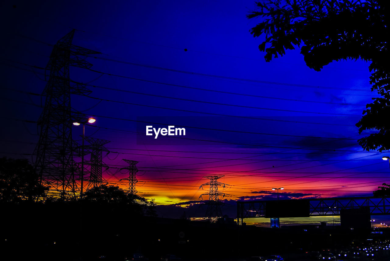 cable, power line, sky, sunset, electricity pylon, power supply, silhouette, electricity, night, no people, built structure, connection, fuel and power generation, outdoors, technology, tree, nature, building exterior, illuminated, beauty in nature, architecture, scenics, telephone line
