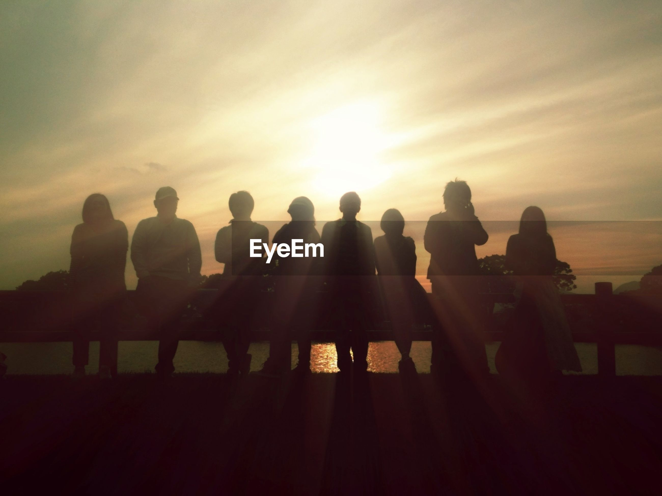 silhouette, sunset, sky, sun, sunlight, men, large group of people, person, lifestyles, medium group of people, tranquility, leisure activity, sunbeam, nature, tranquil scene, togetherness, scenics, outline, beauty in nature
