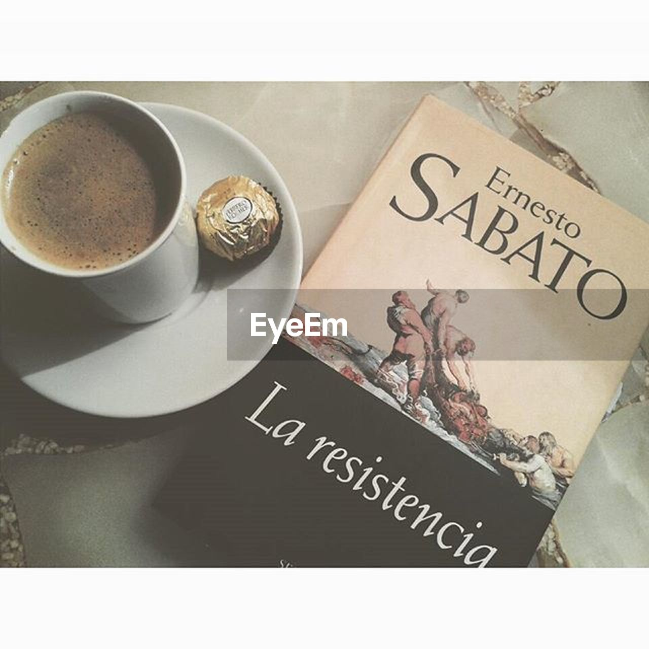 text, western script, coffee cup, high angle view, communication, food and drink, coffee - drink, refreshment, drink, close-up, no people, indoors, day, freshness
