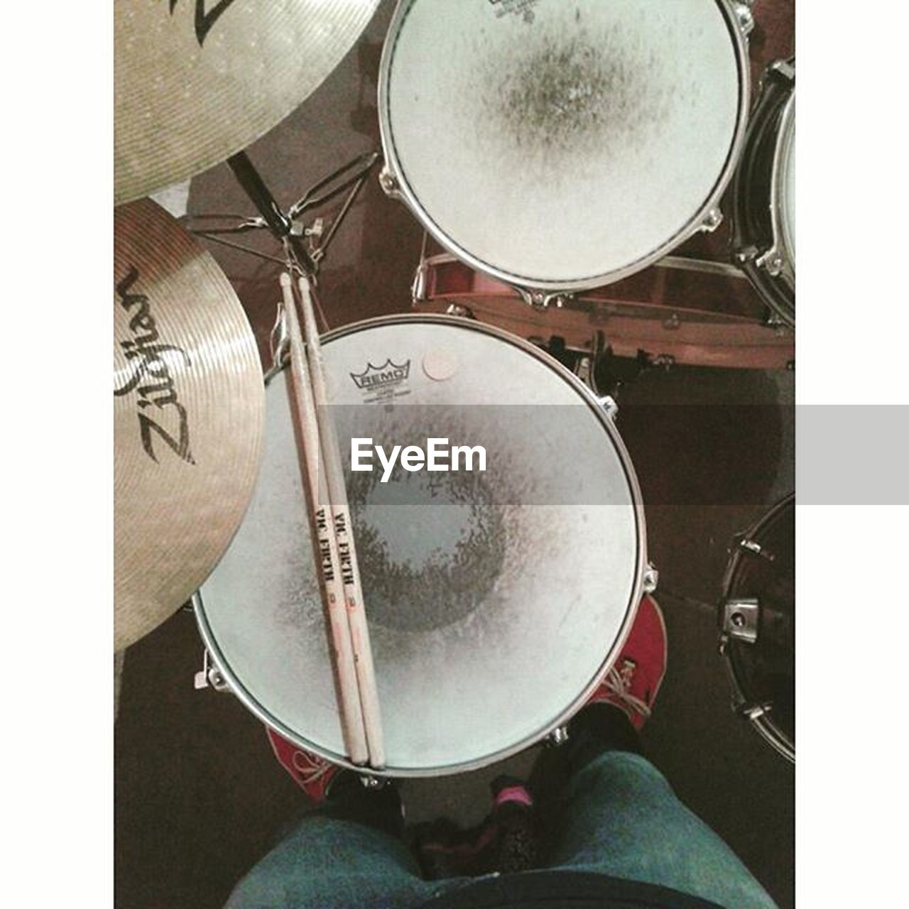 drum - percussion instrument, music, drum kit, arts culture and entertainment, musical instrument, low section, drumstick, drummer, cymbal, indoors, real people, one person, leisure activity, close-up, lifestyles, musician, men, day, people