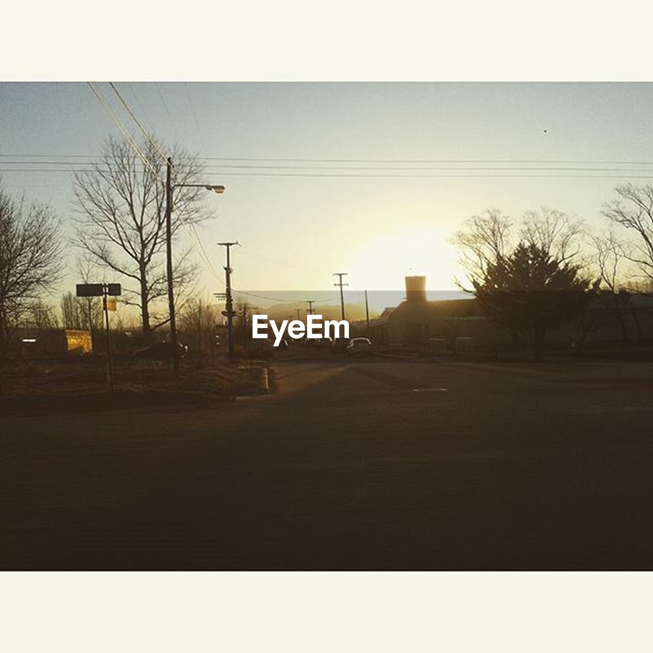 tree, no people, car, transportation, road, bare tree, outdoors, sunset, clear sky, nature, sky, electricity pylon, day, city