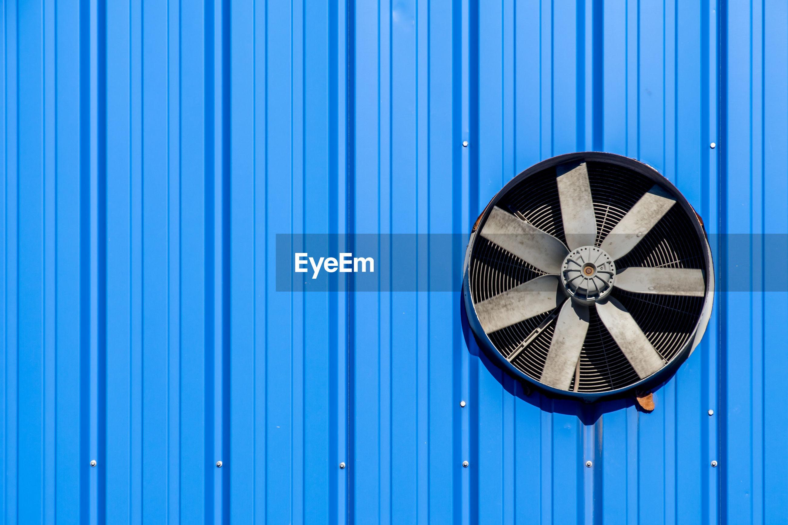 Full frame shot of equipment on blue wall