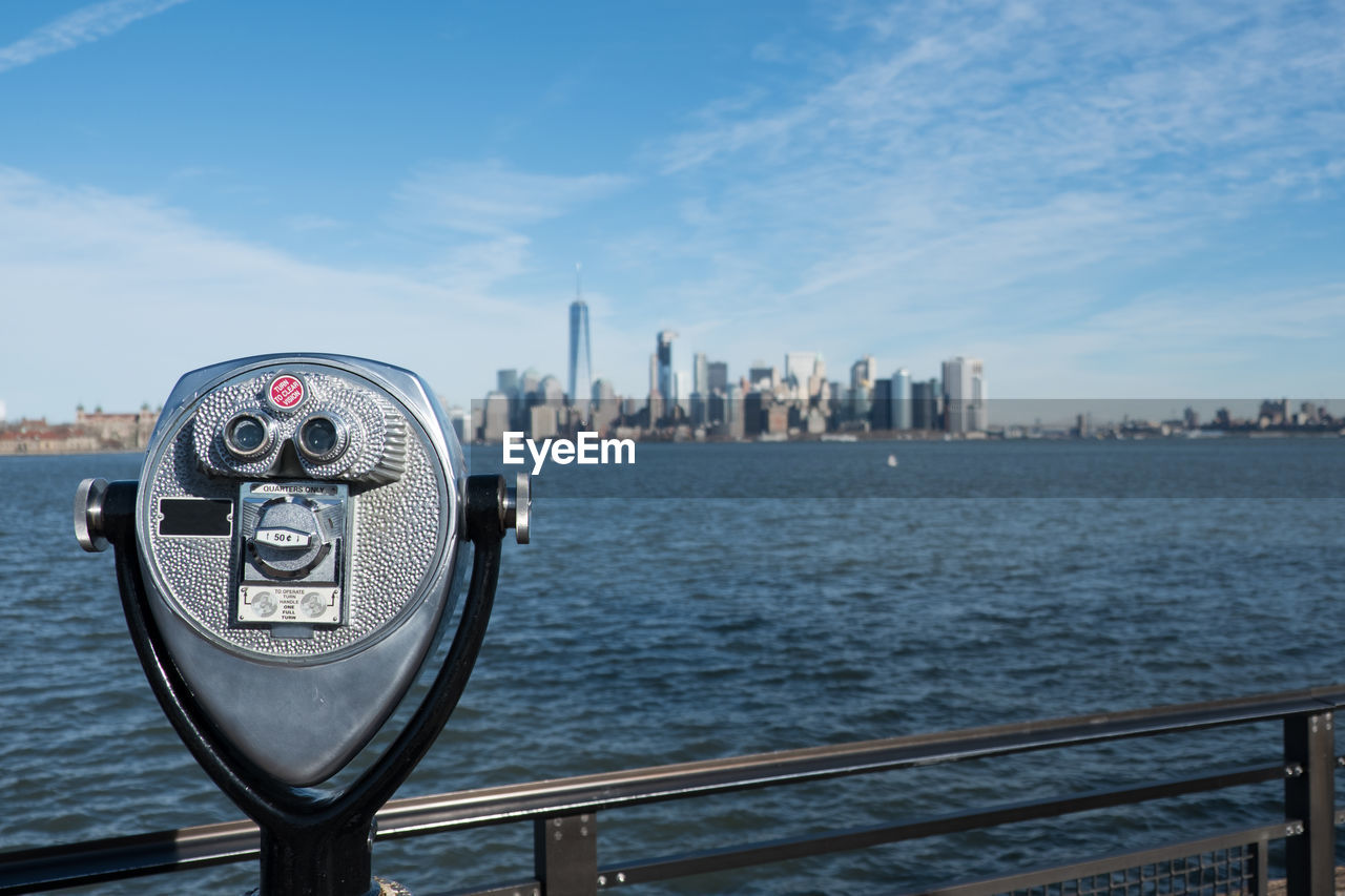 Coin-Operated Binocular By River In City