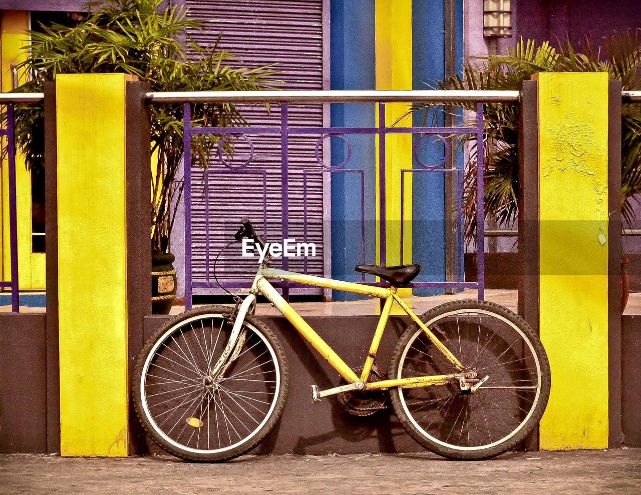 BICYCLE PARKED ON ROADSIDE