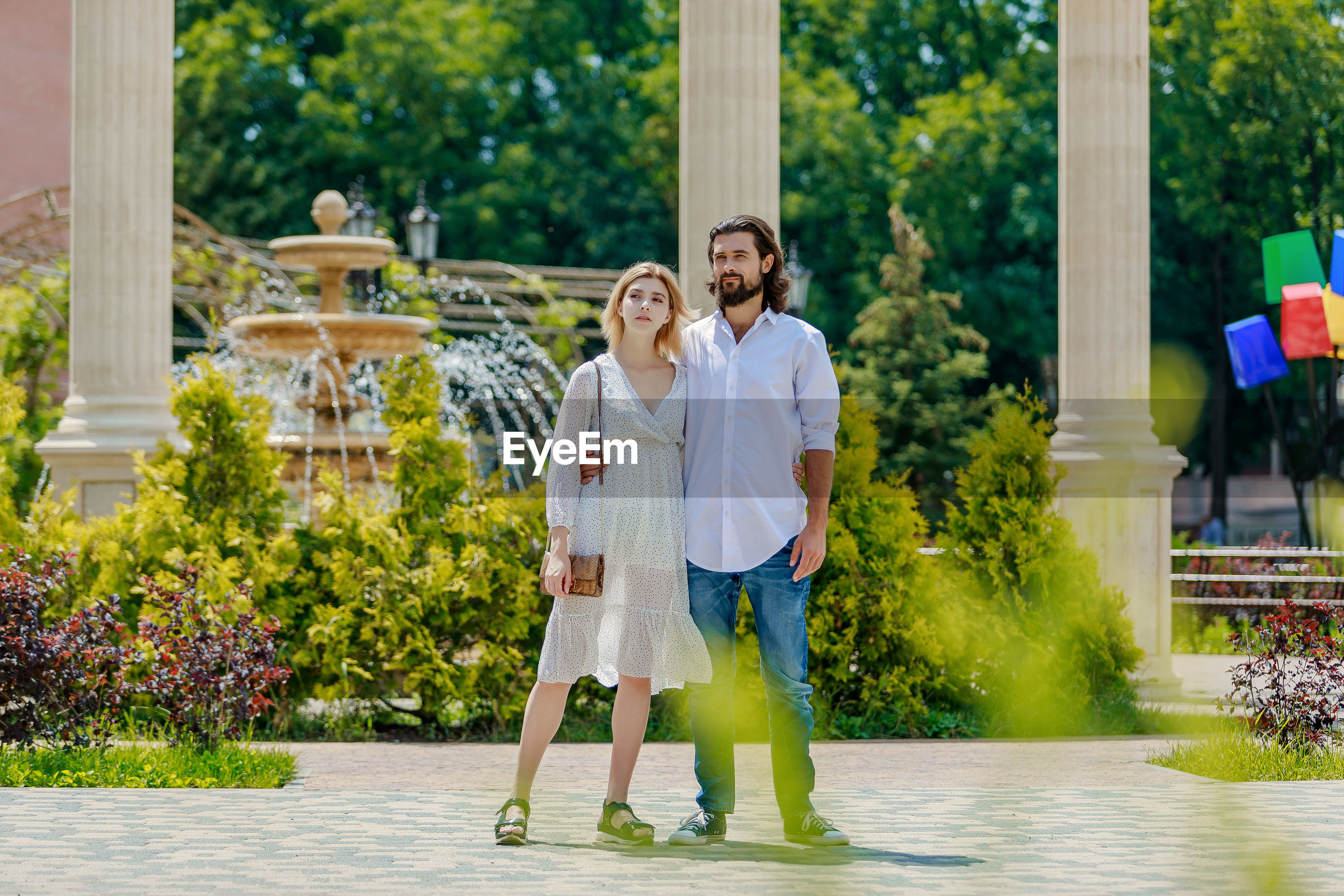 Portrait of smiling couple standing outdoors