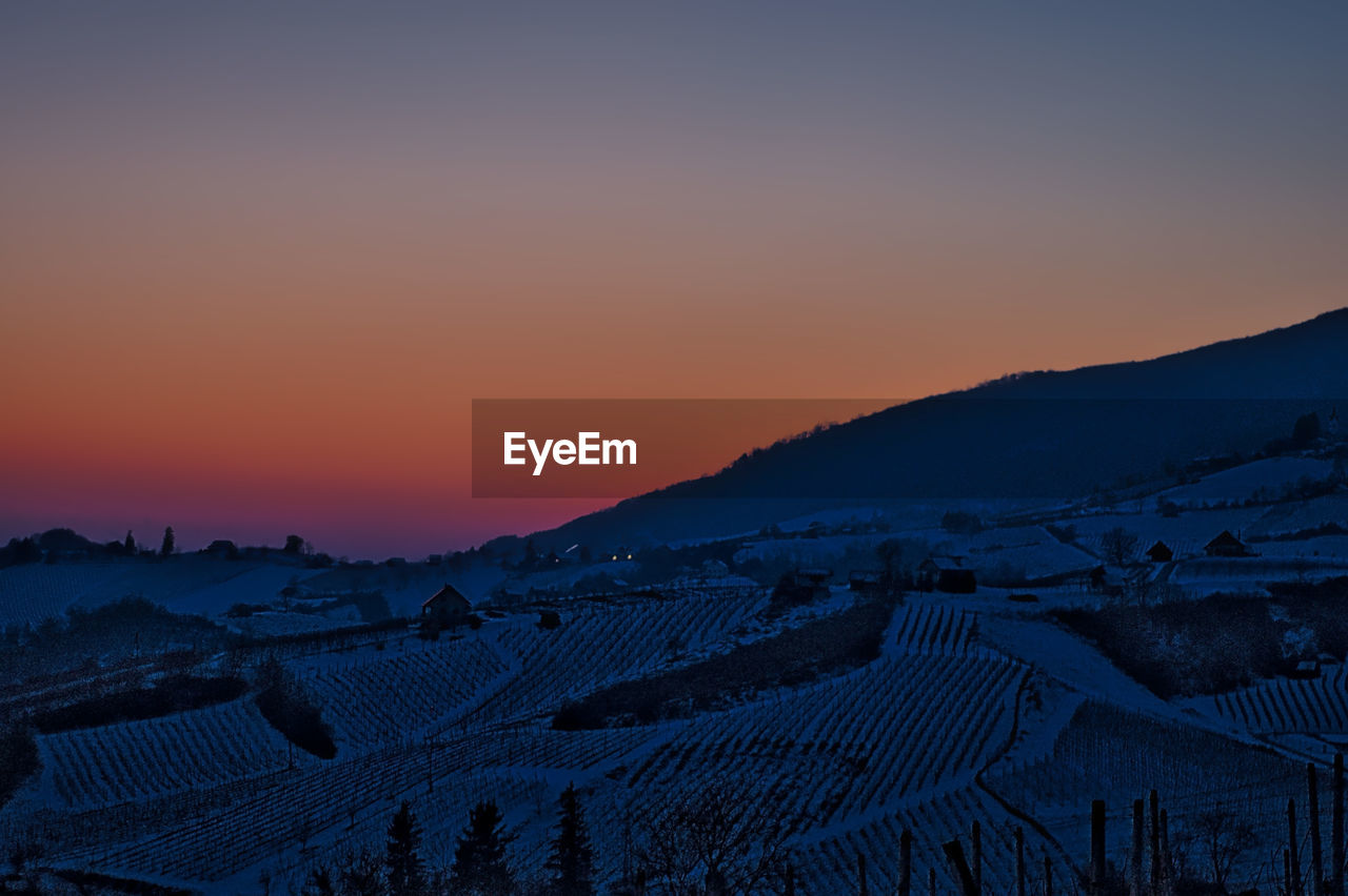 sunset, sky, scenics - nature, beauty in nature, landscape, environment, mountain, tranquil scene, tranquility, orange color, nature, land, no people, idyllic, rural scene, agriculture, mountain range, clear sky, non-urban scene, winter