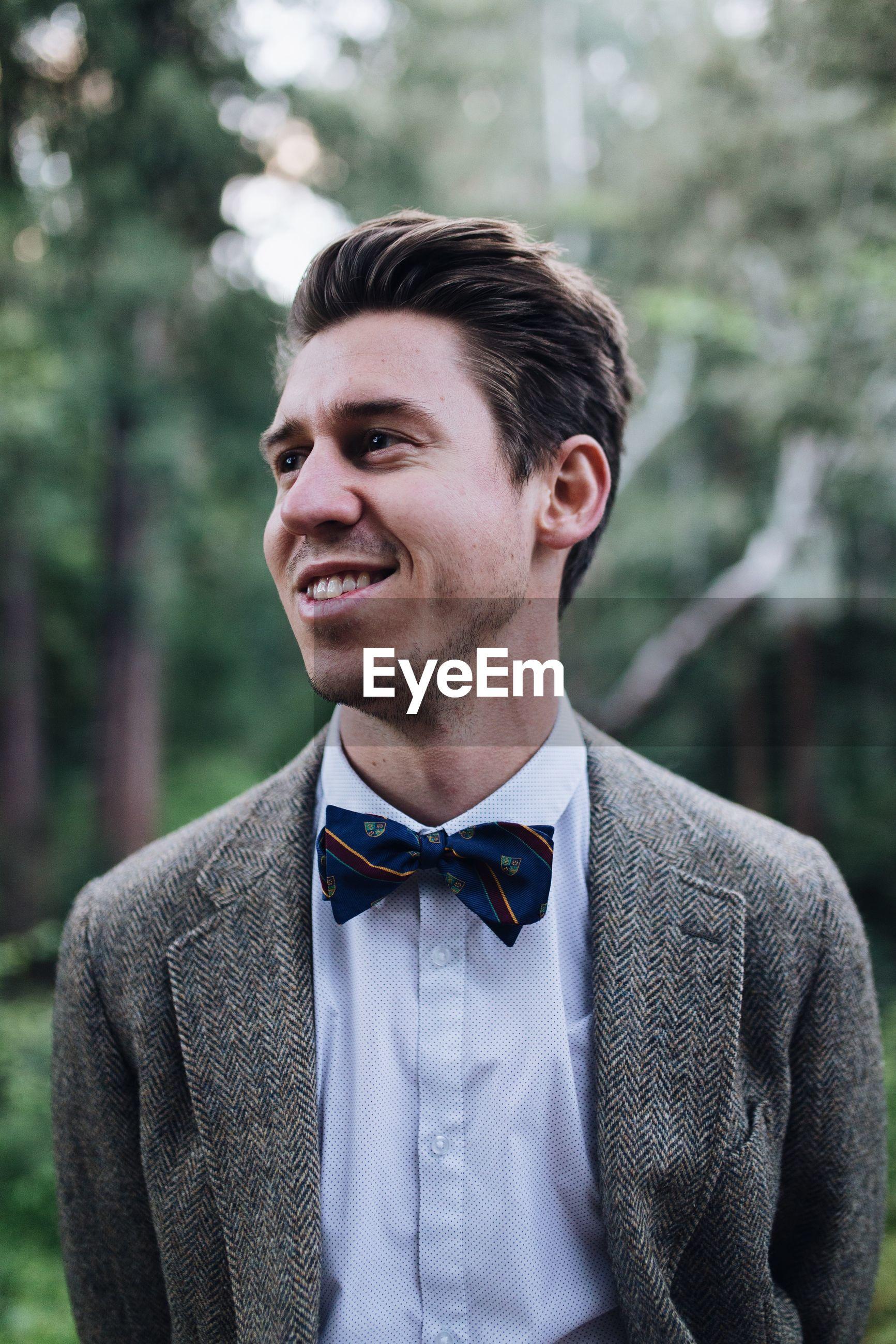 Close-up of smiling man wearing suit