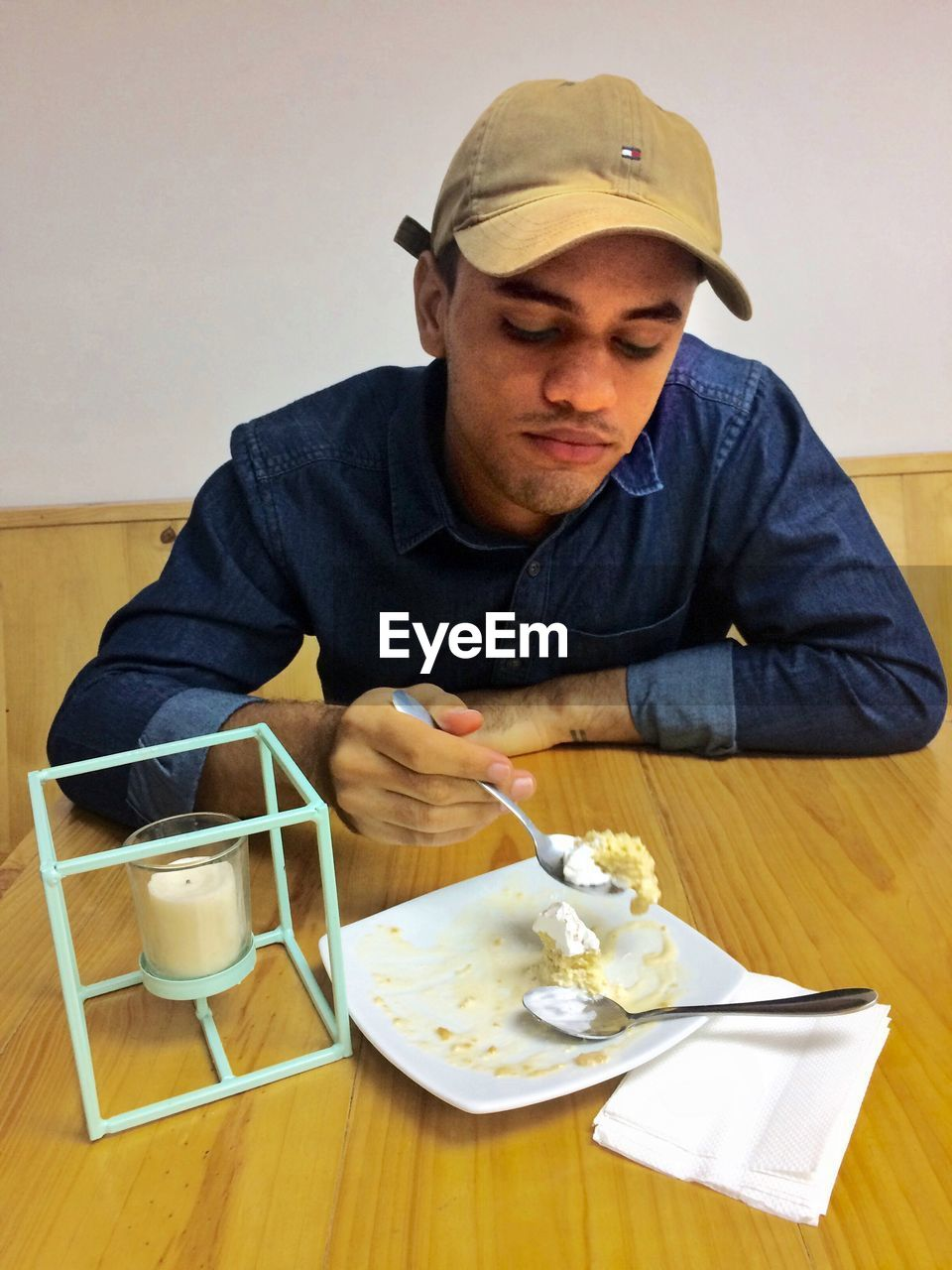Man having food while sitting at table in cafe