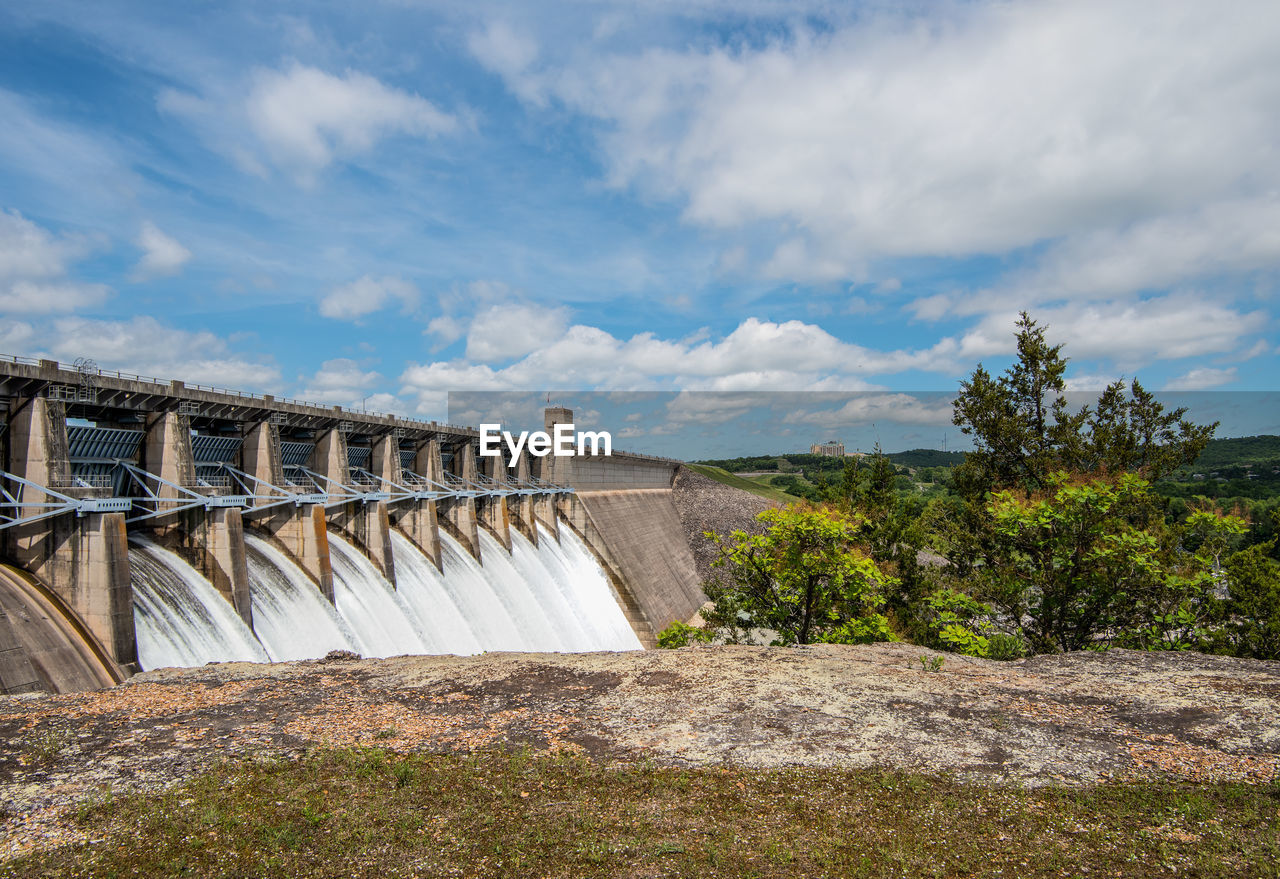 cloud - sky, sky, dam, built structure, hydroelectric power, nature, architecture, plant, water, day, no people, renewable energy, beauty in nature, fuel and power generation, tree, scenics - nature, environmental conservation, environment, connection, outdoors, flowing water, concrete, flowing, water conservation