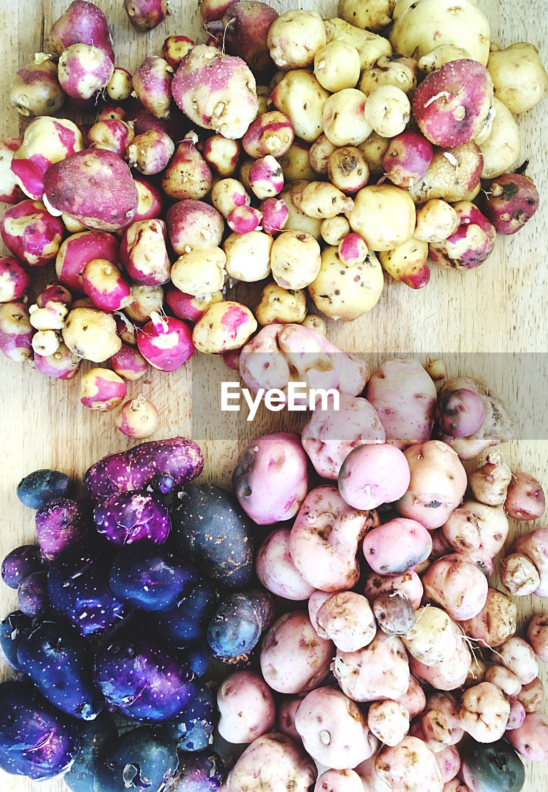 Directly above shot of colorful potatoes for sale at market stall