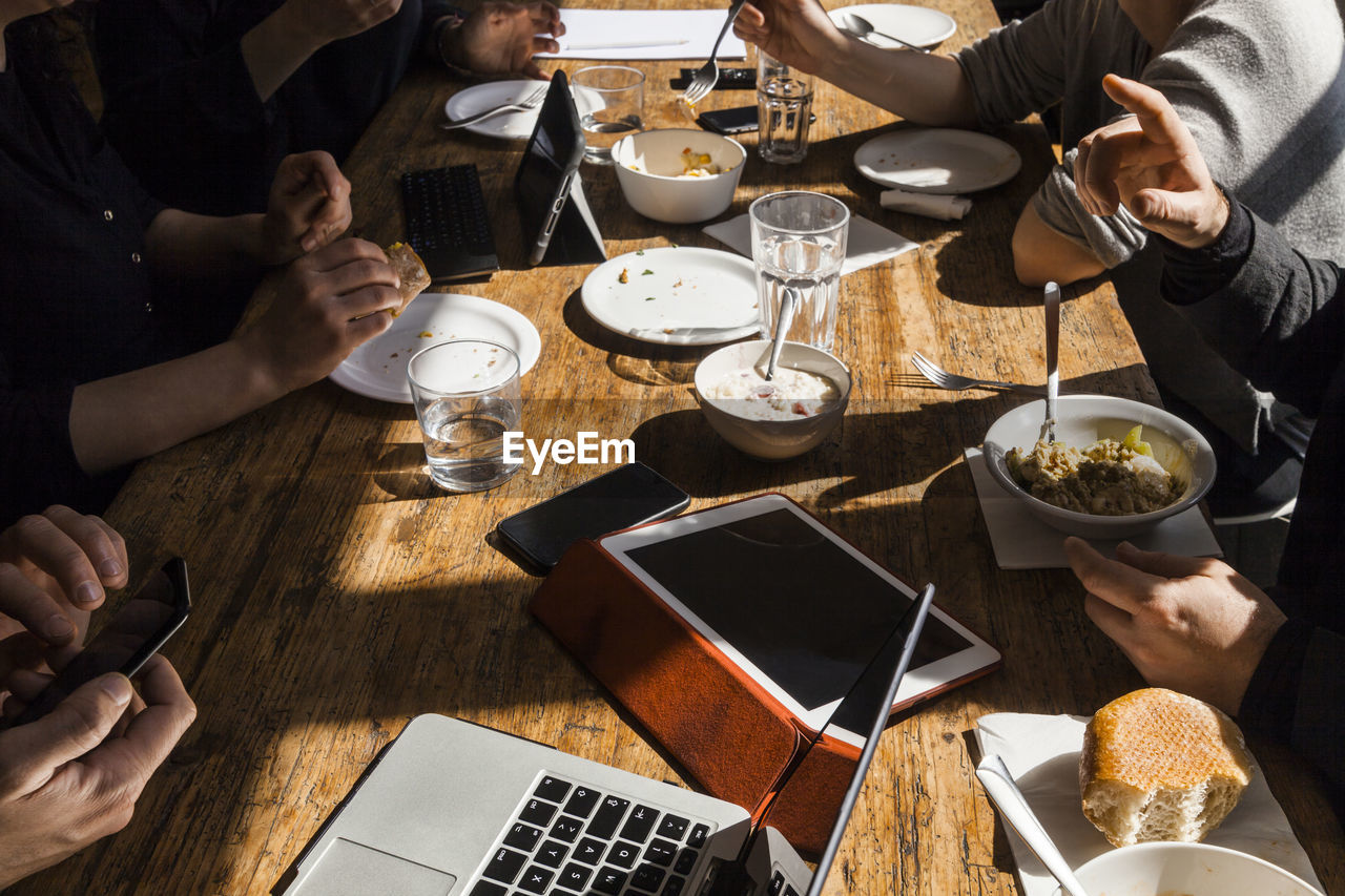 HIGH ANGLE VIEW OF PEOPLE ON TABLE AT RESTAURANT