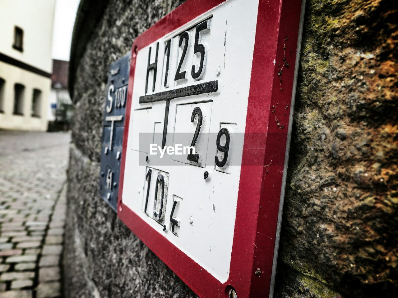 number, text, day, communication, outdoors, red, no people, built structure, architecture, close-up, building exterior
