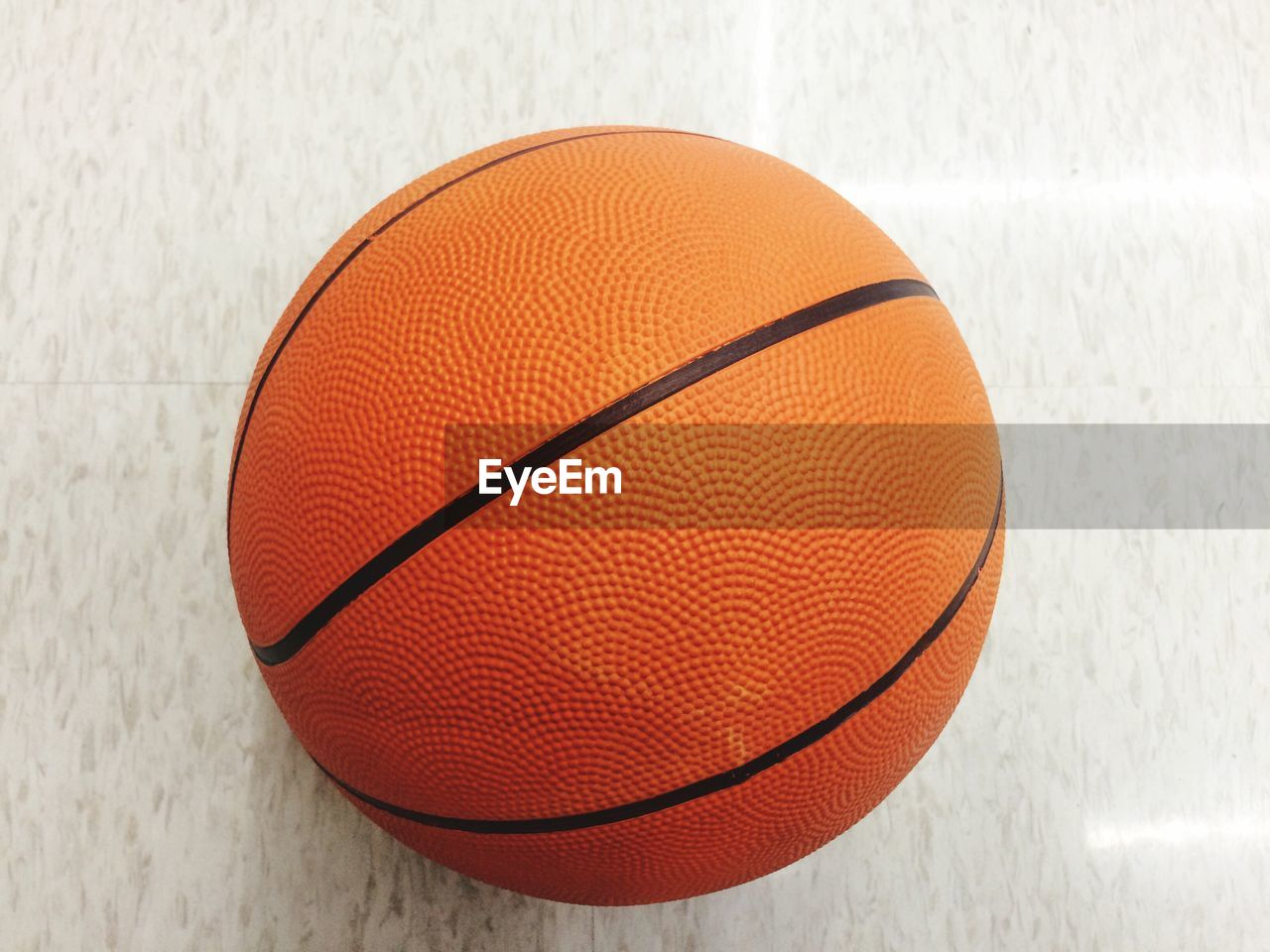 Close-up of basketball on floor