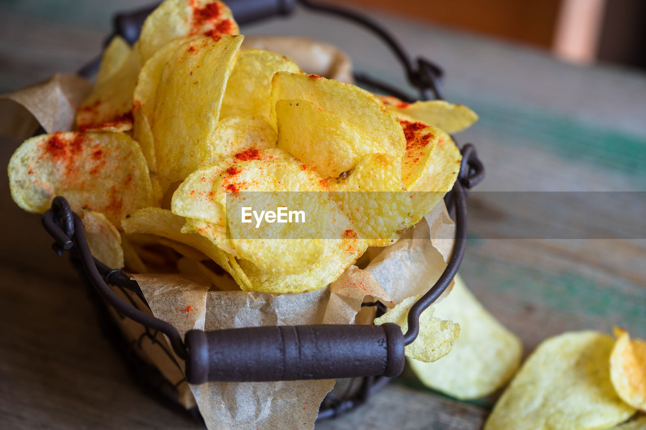 High Angle View Of Fresh Crunchy Potato Chips On Table