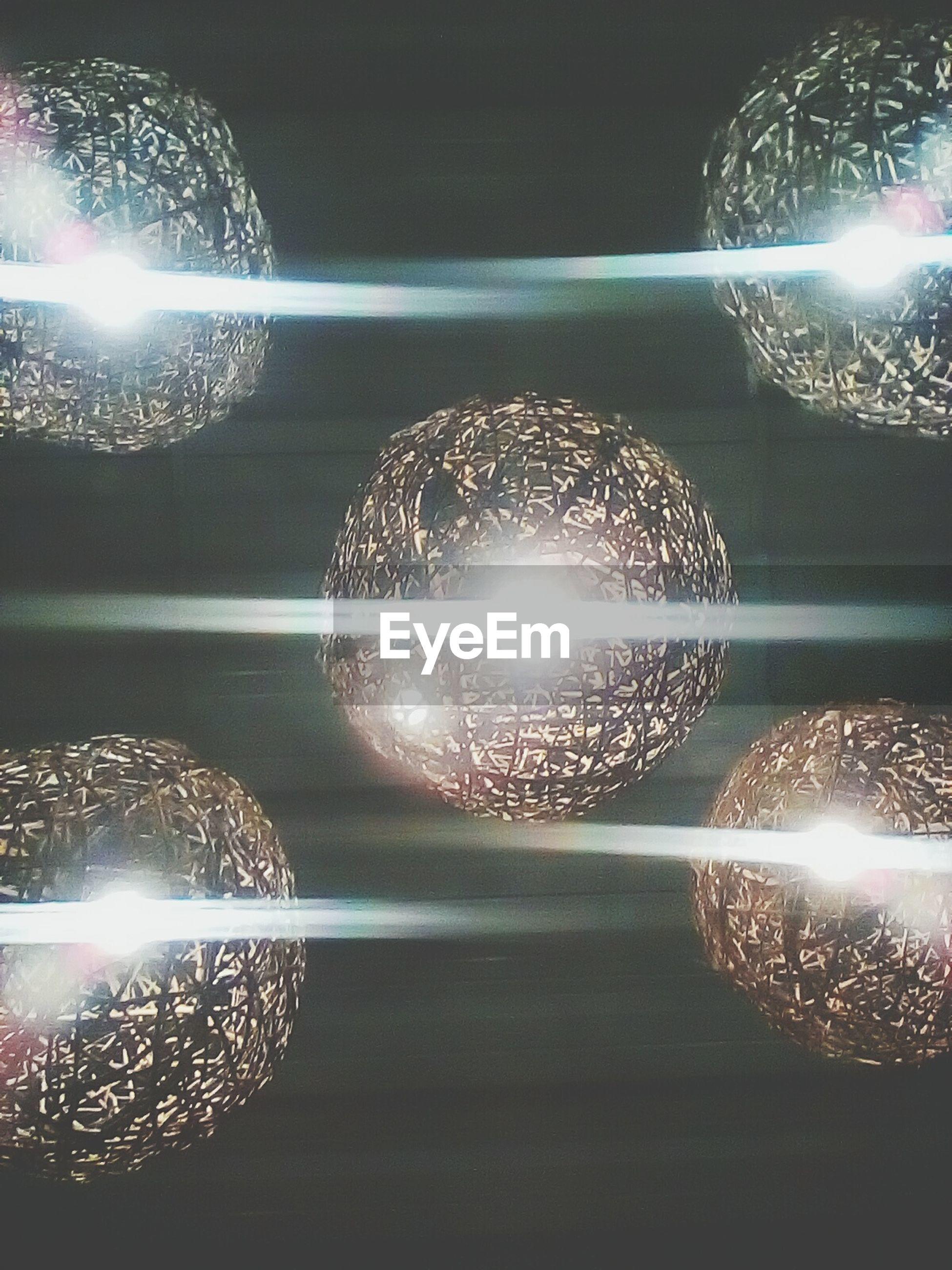Low angle view of illuminated circular lights